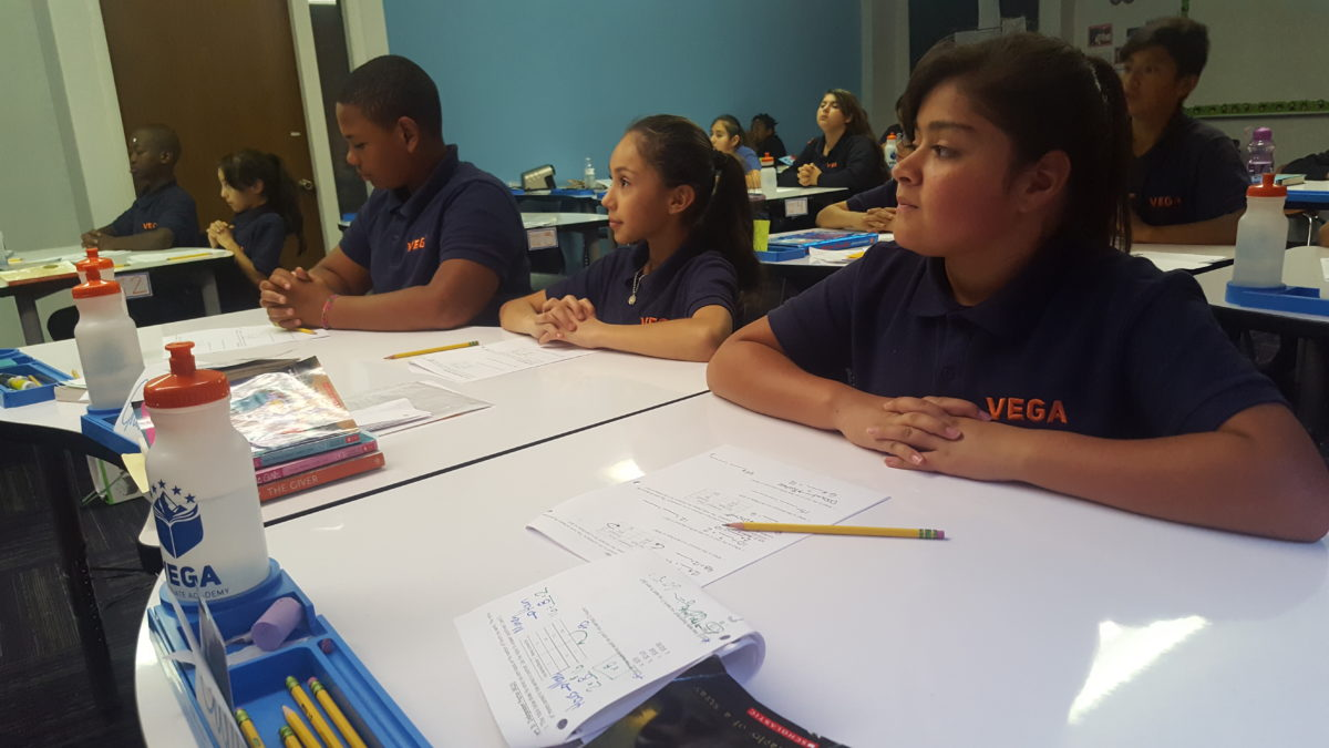 Sixth graders listen to a math lesson at Vega Collegiate Academy in Aurora during a September 2018 class.