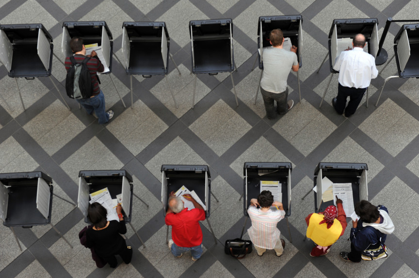 Denver voters fill out their ballot at the Webb municipal building.