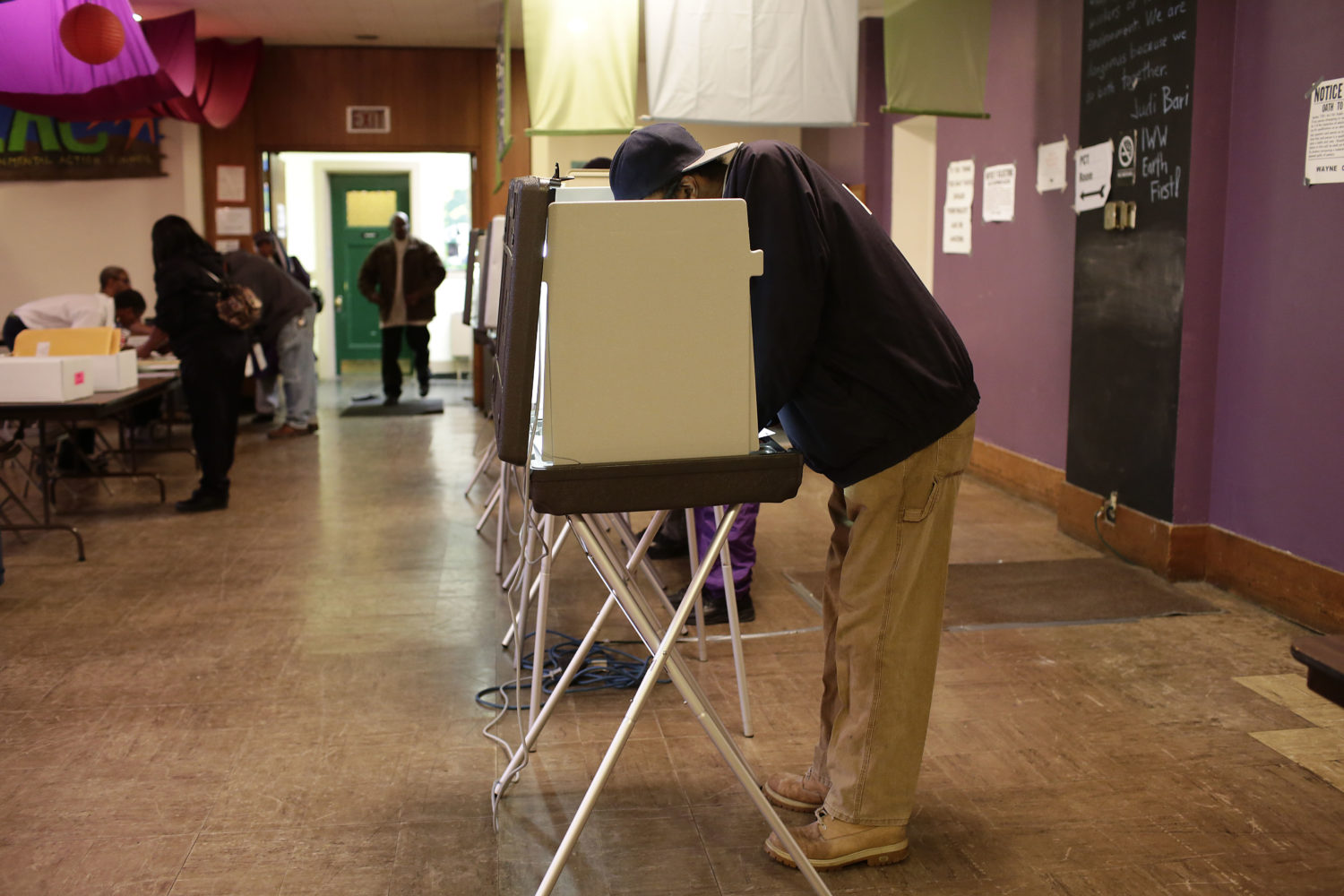A man fills out his ballot at a polling station during the midterm elections Nov. 4, 2014 in Detroit.