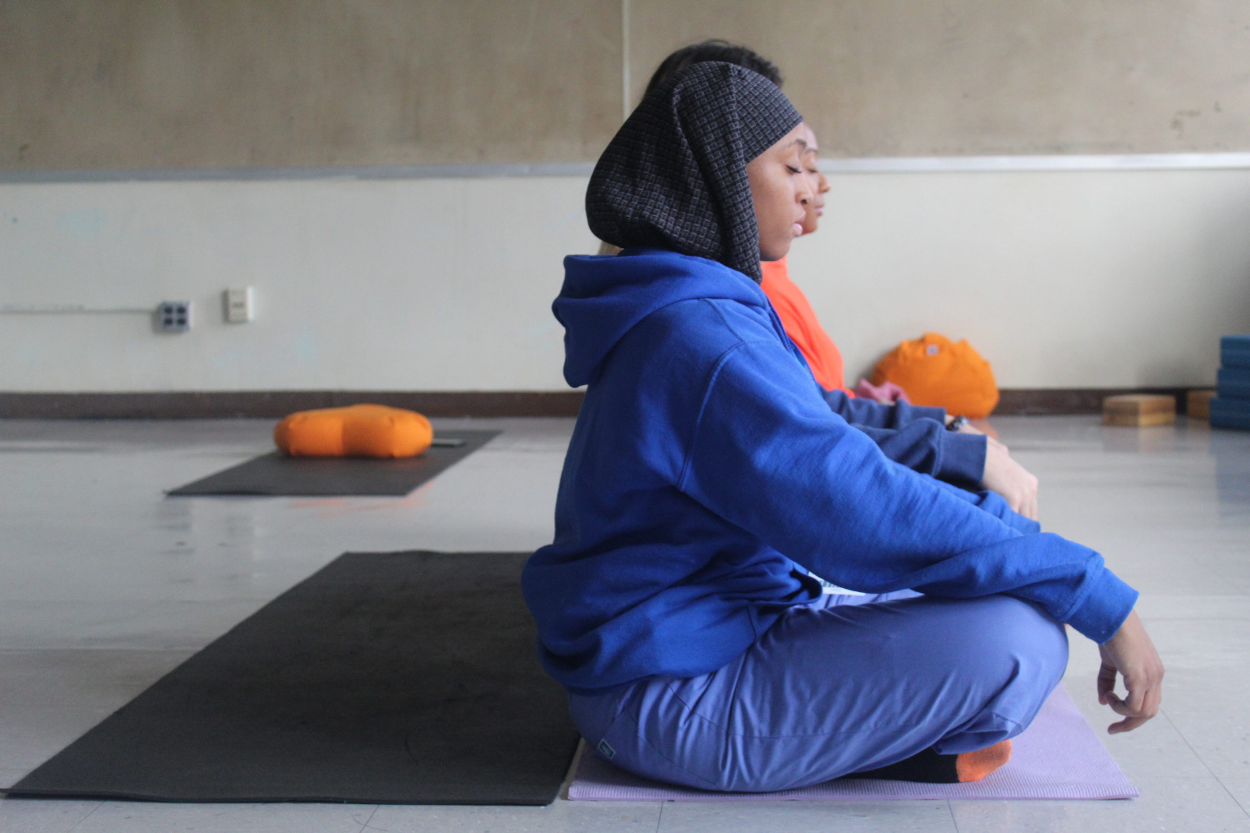 Newark high school students close their eyes and practice meditation.
