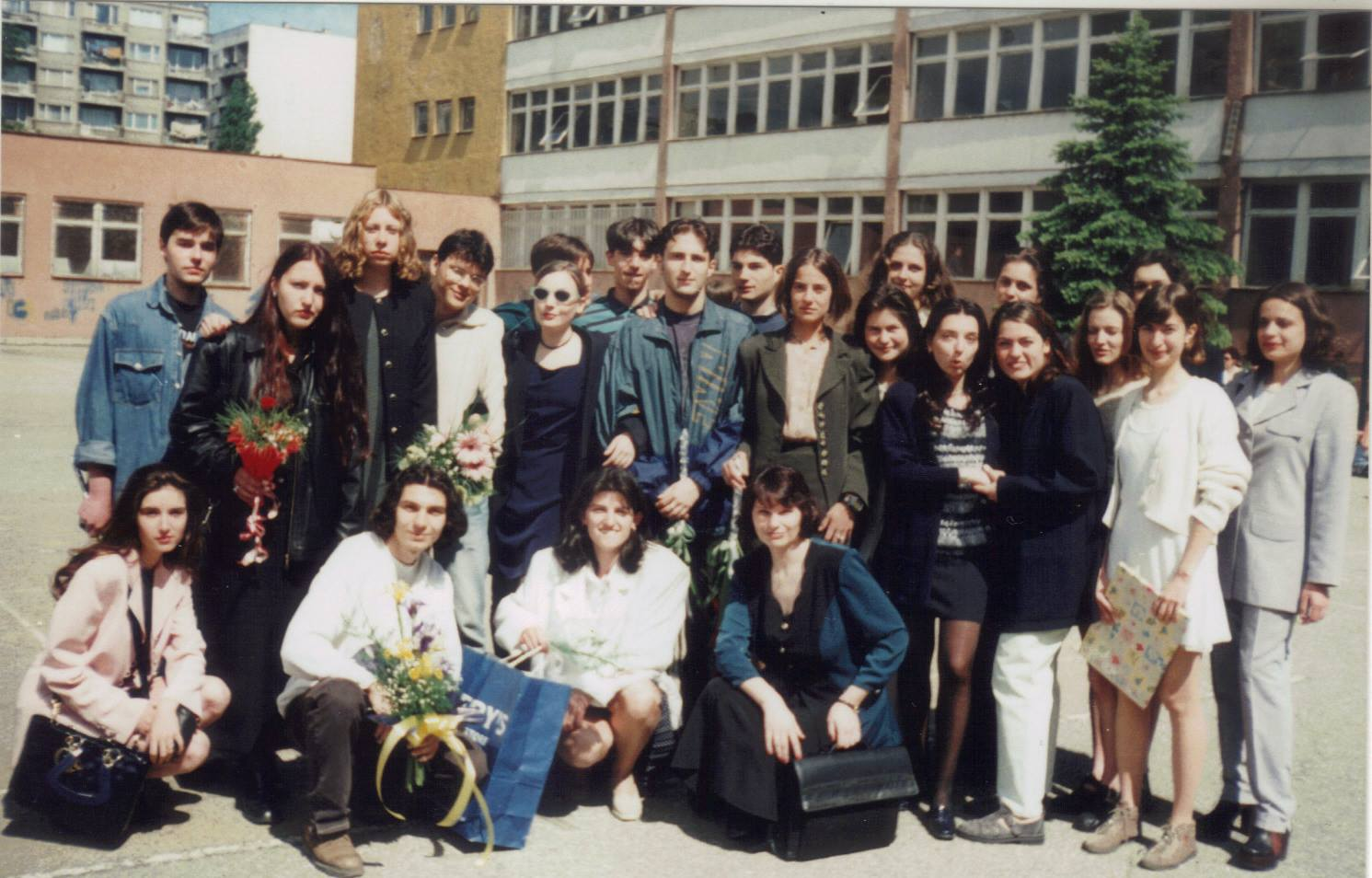 Chalkbeat Chicago reporter Mila Koumpilova (pictured second from right in a white dress) at age 18 with her class in front of her high school in Sofia, Bulgaria.