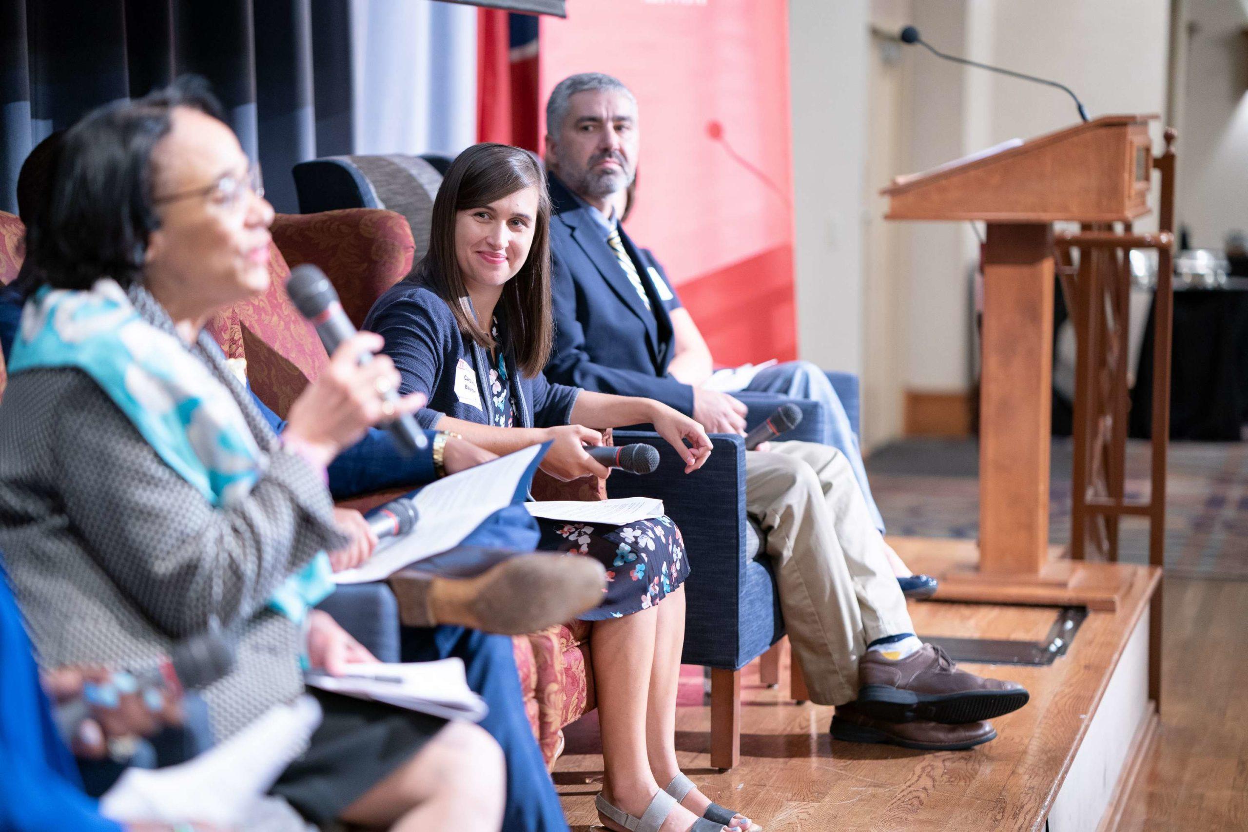 Caroline Bauman (center) moderates a panel in 2019 on teacher diversity and talent.
