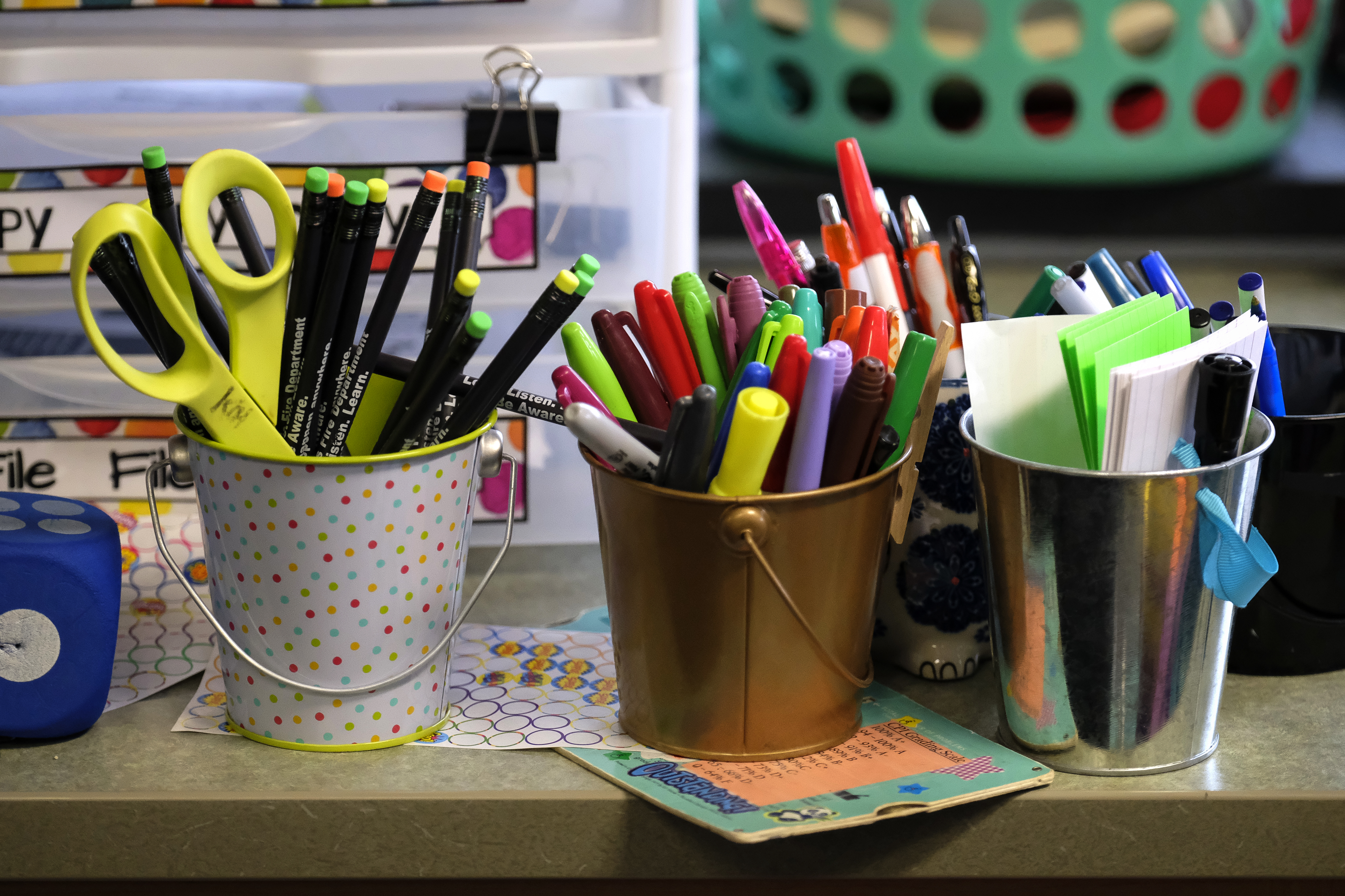 Containers hold markers and scissors in a classroom at Thomas Gregg Neighborhood School, an elementary school in Indianapolis, Indiana. —April, 2019— Photo by Alan Petersime/Chalkbeat