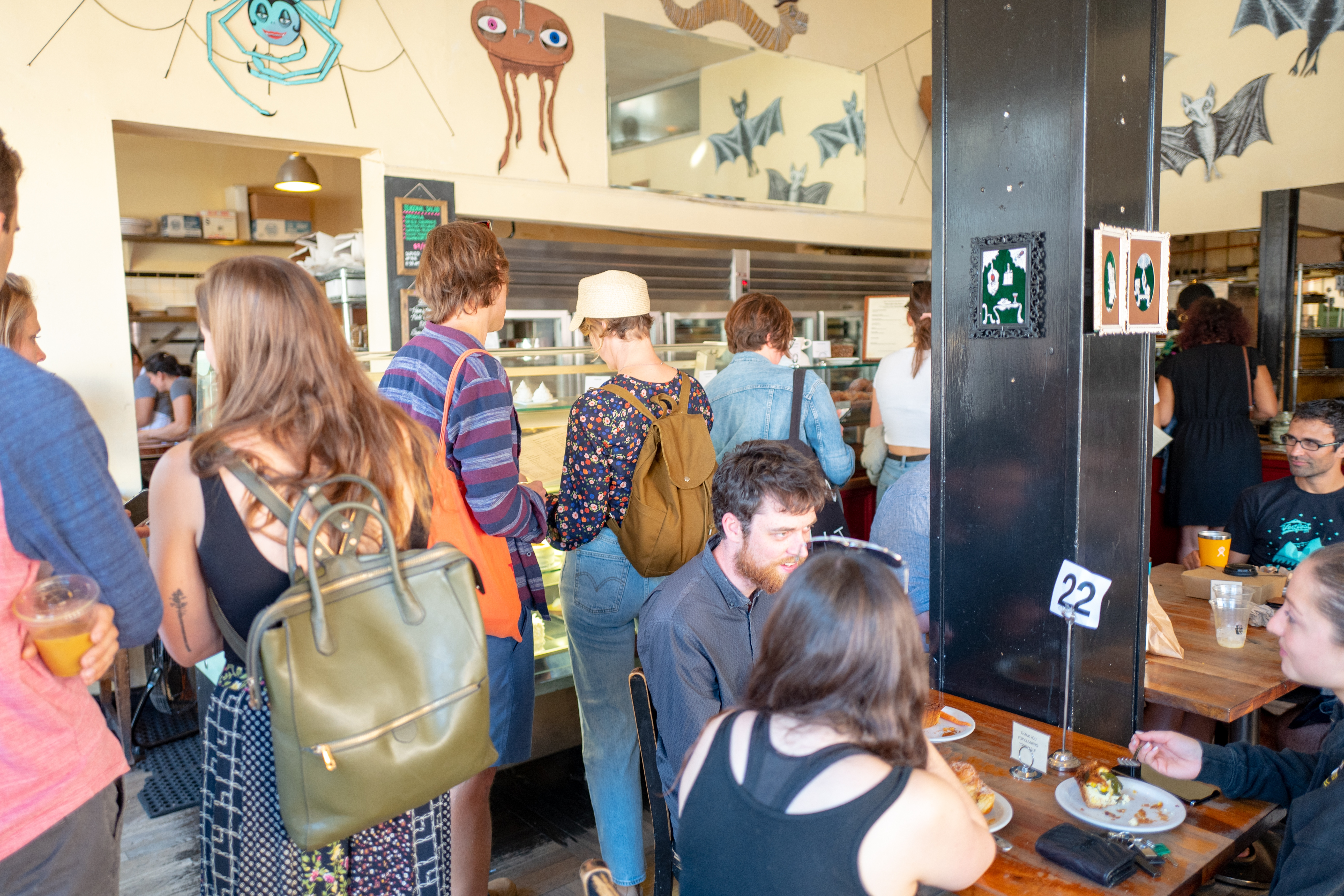 A crowd of diners inside Tartine's Mission District bakery