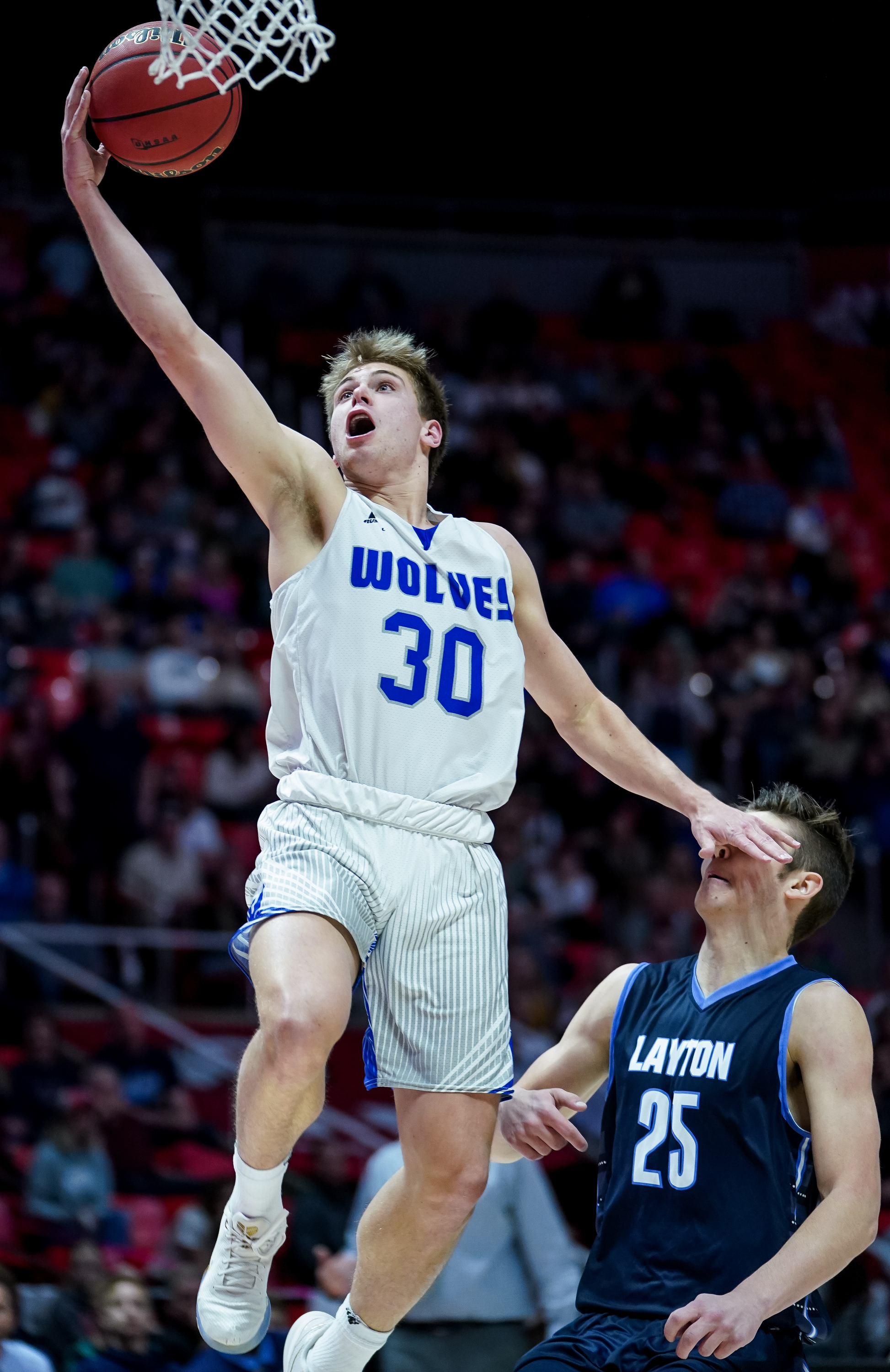 Fremont's Dallin Hall goes to the hoop ahead of Layton's Boston Painter in a 6A boys basketball semifinal game at the Huntsman Center in Salt Lake City on Friday, Feb. 28, 2020.