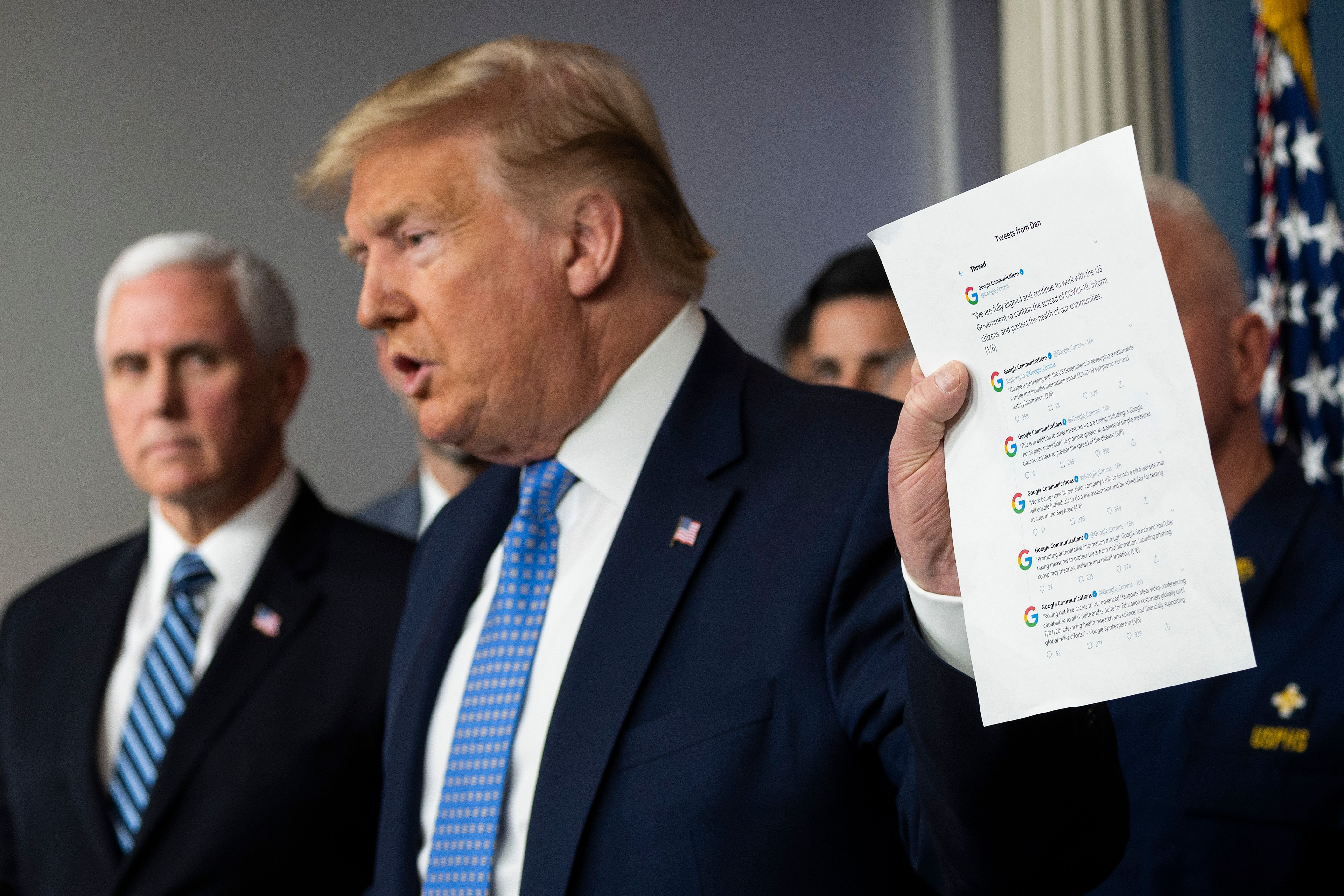 President Trump holds up a printout of tweets from Google's communication team at a press conference on March 15, 2020.