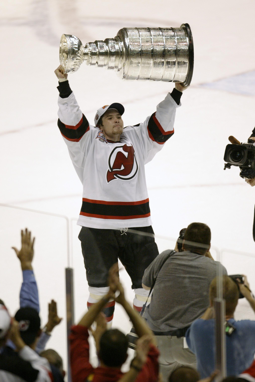 Sergei Brylin raises the Stanley Cup