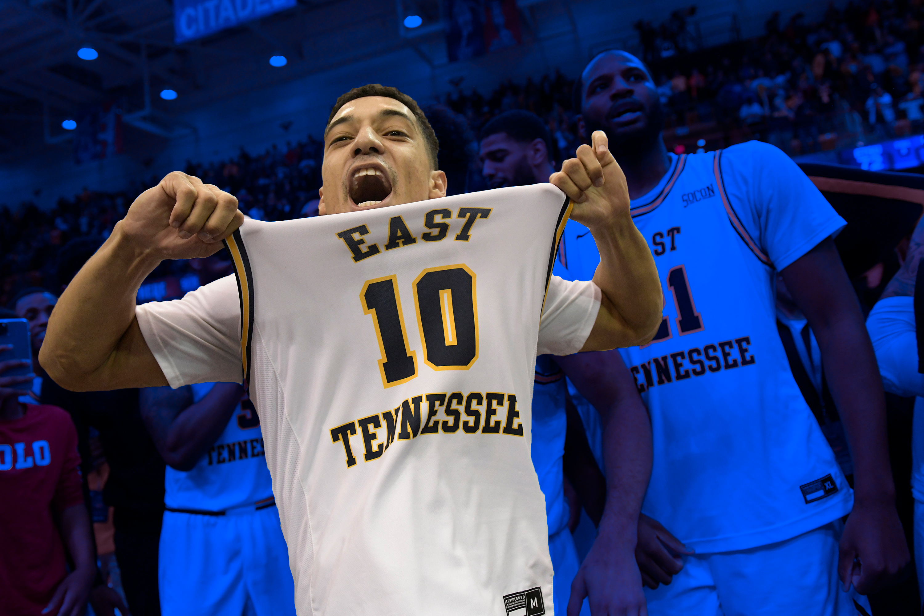 East Tennessee State basketball celebrates.