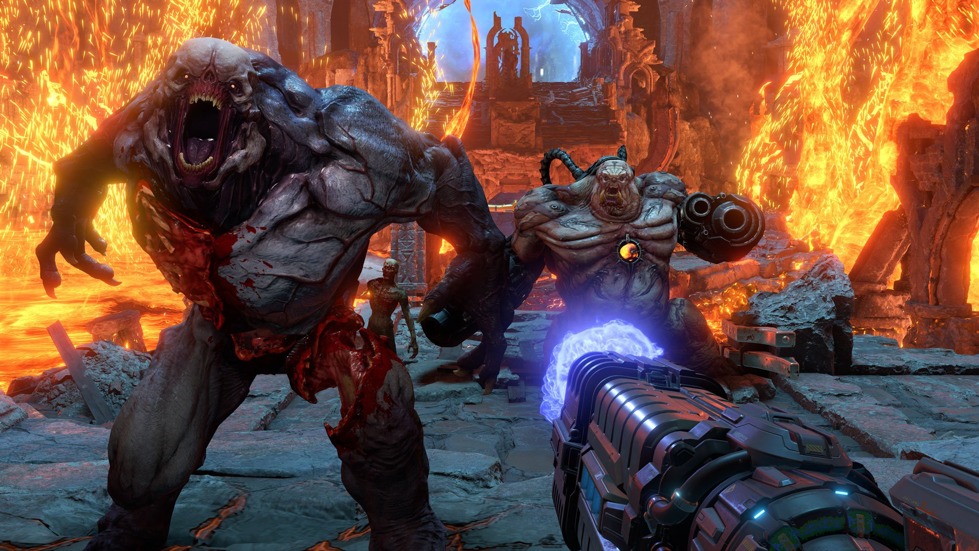 demons in a hellish environment charge the player in Doom Eternal