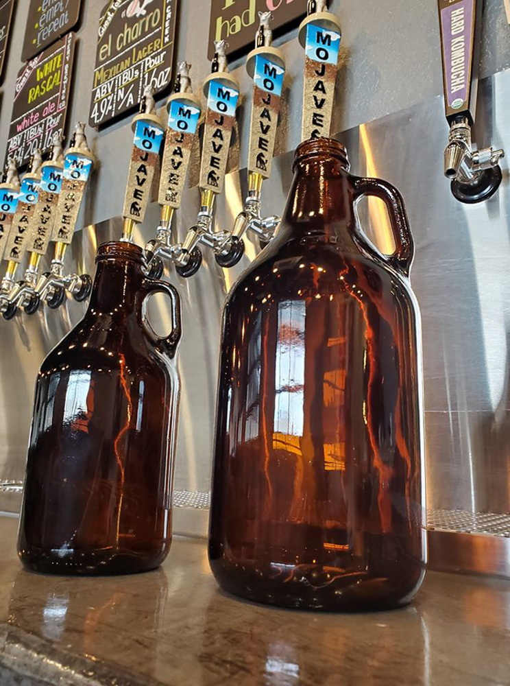 A collection of growlers on display in Water Street's Mojave Brewing Company.