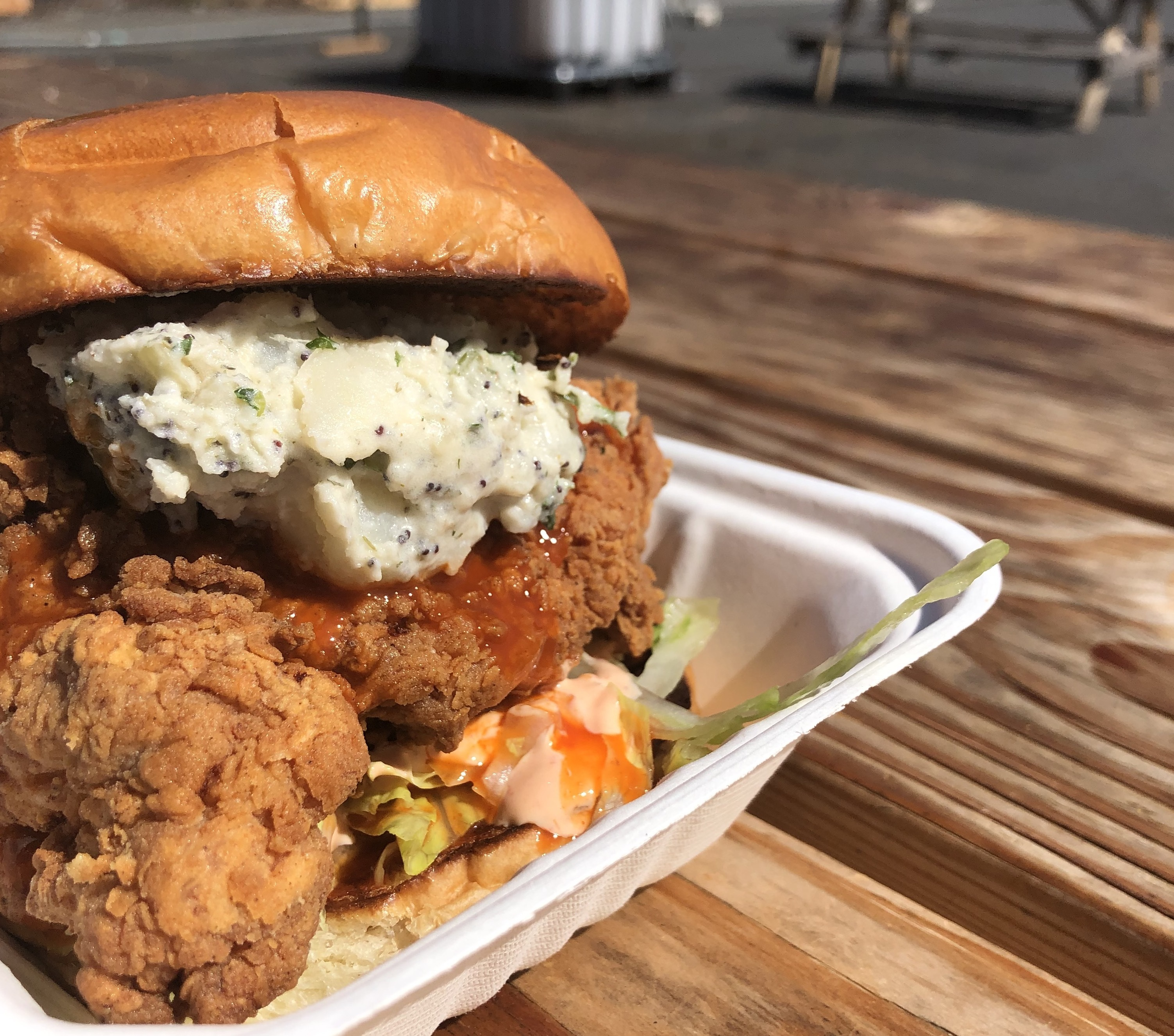 A picture of a Jojo chicken sandwich with potato salad and sambal mayo