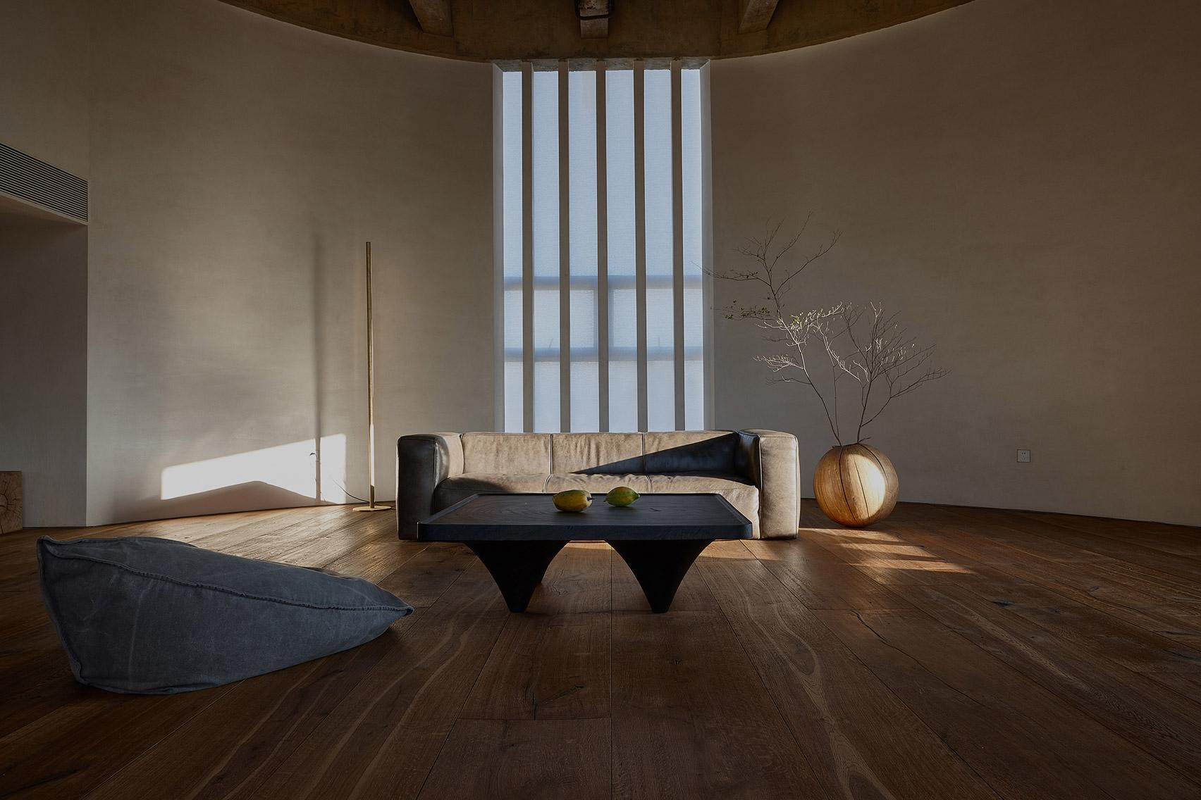 Sofa in cavernous living room.