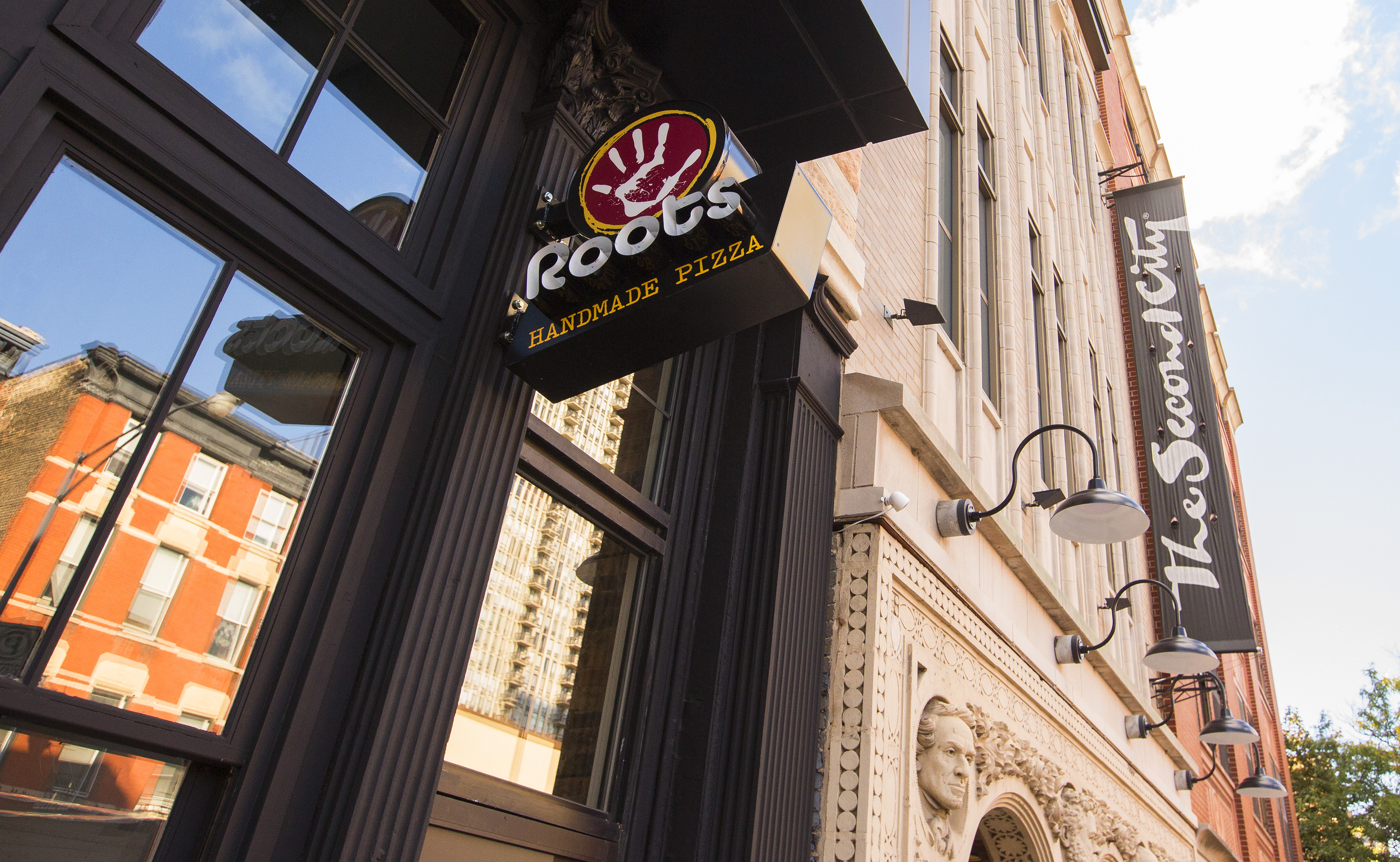 The exterior of Roots Pizza.