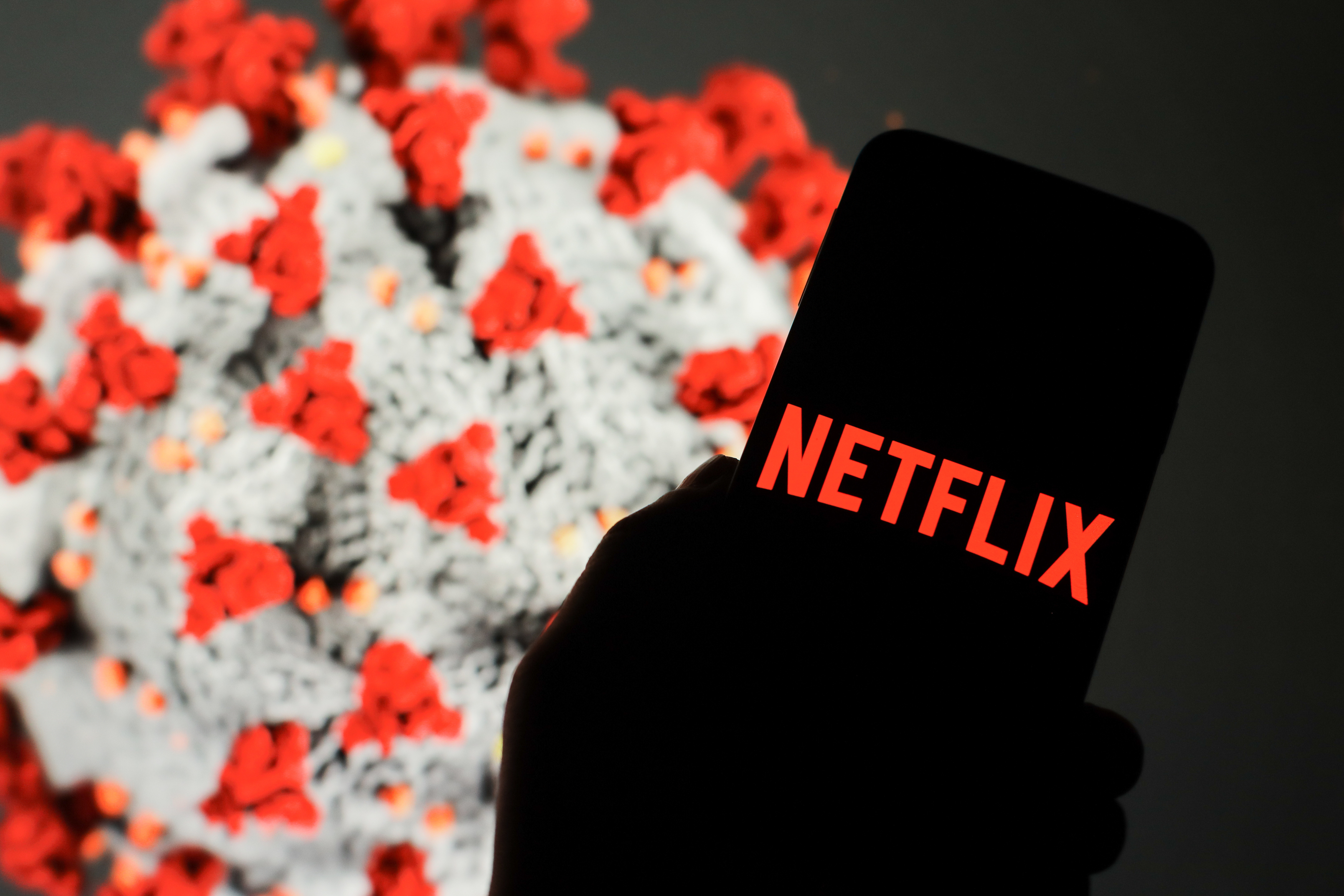 In this photo illustration a Netflix logo seen displayed on...