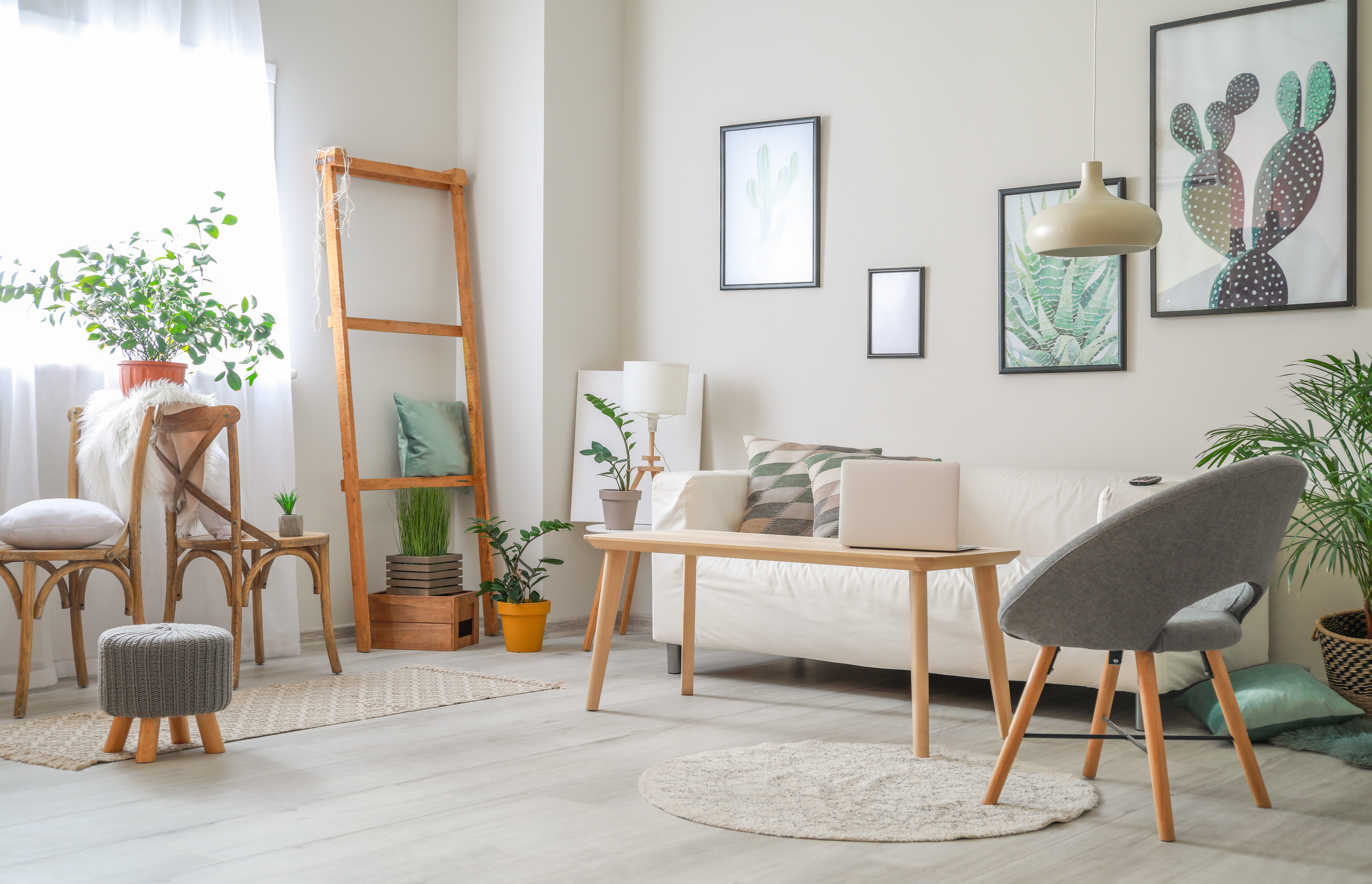 A white living room with gray and wood furniture.
