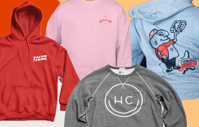 Four restaurant merch sweatshirts on colorful background