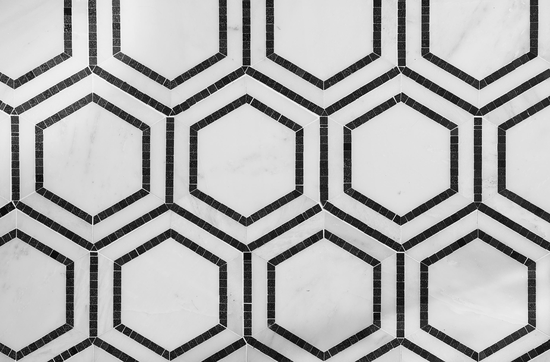 Hexagon patterned ceramic tile flooring.