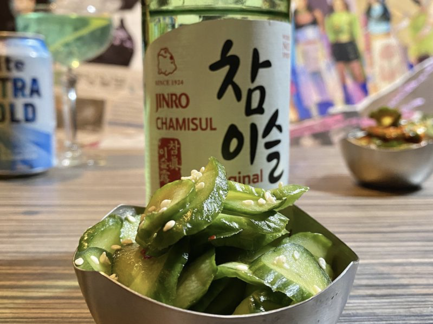 A bottle of soju and bowl of kimchi