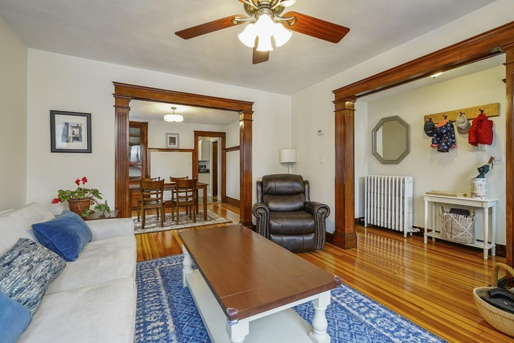 A sturdy living room with wide openings and just off an entry hall.