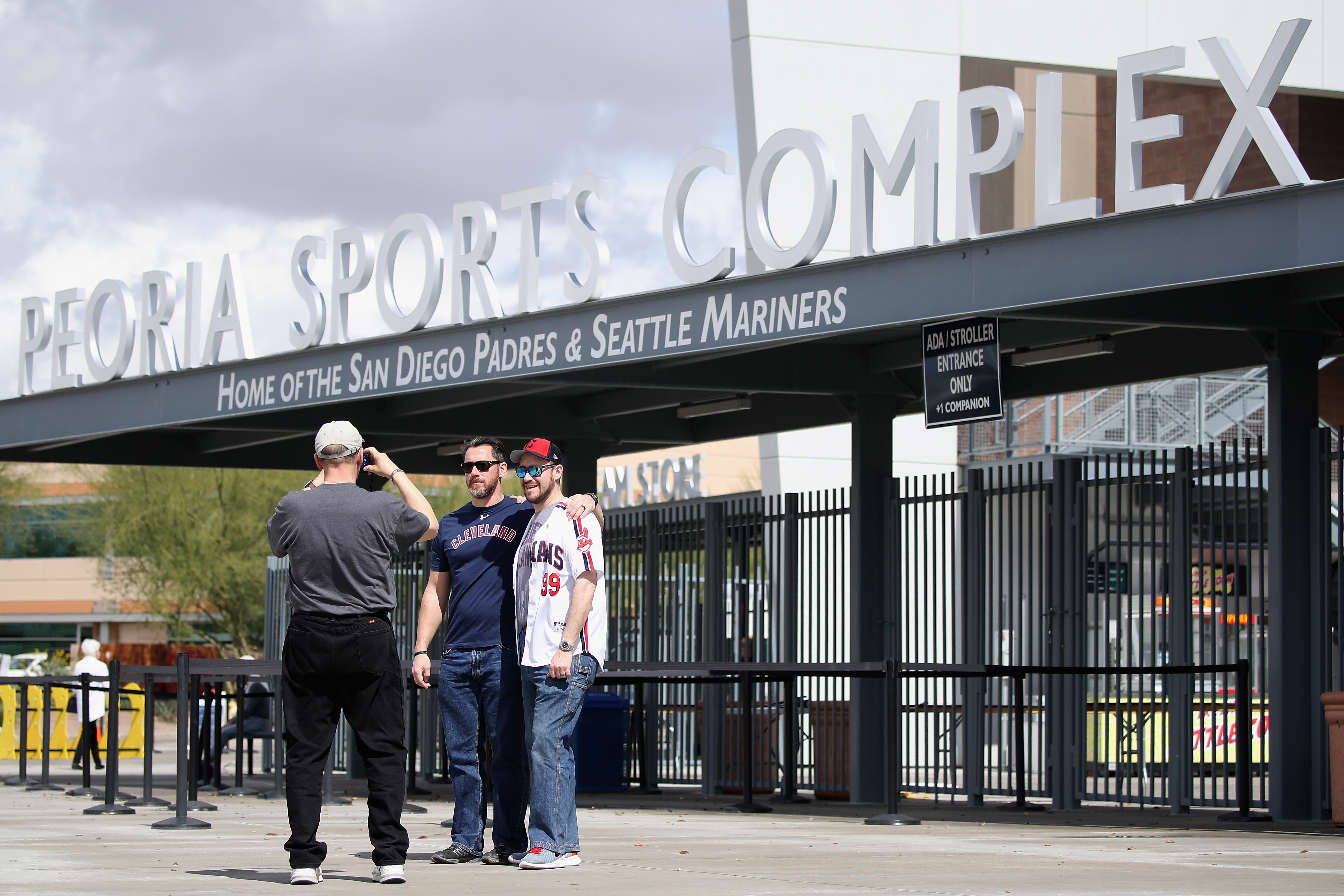 Fans take picture at empty Goodyear stadium
