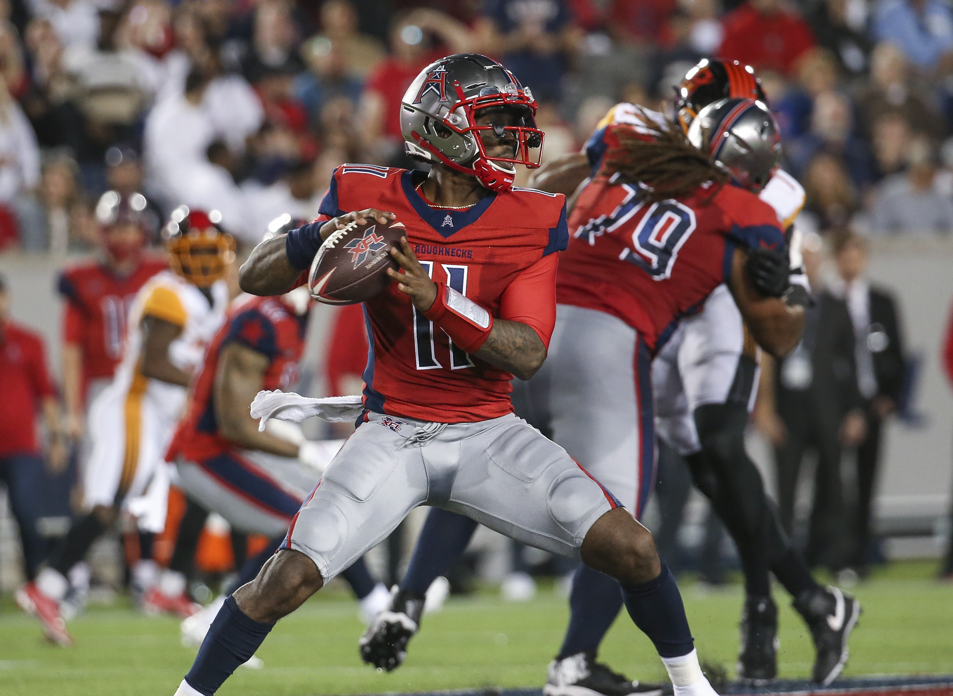 Houston Roughnecks quarterback P.J. Walker drops back to pass against the Los Angeles Wildcats during the third quarter in a XFL football game at TDECU Stadium.