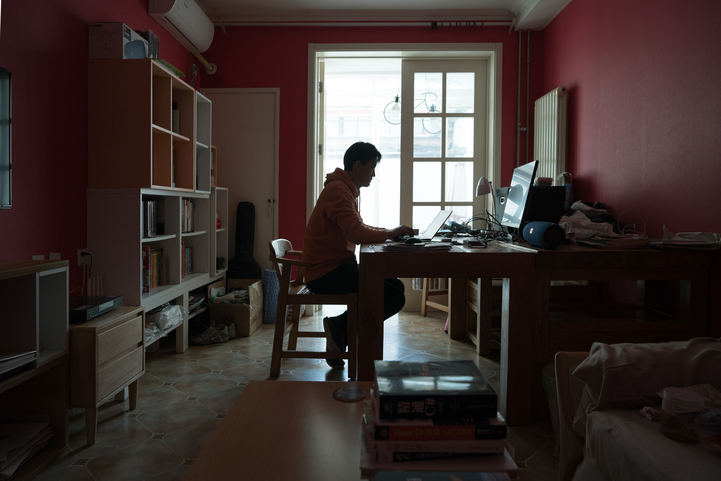 A man in Beijing works from home during the coronavirus outbreak.