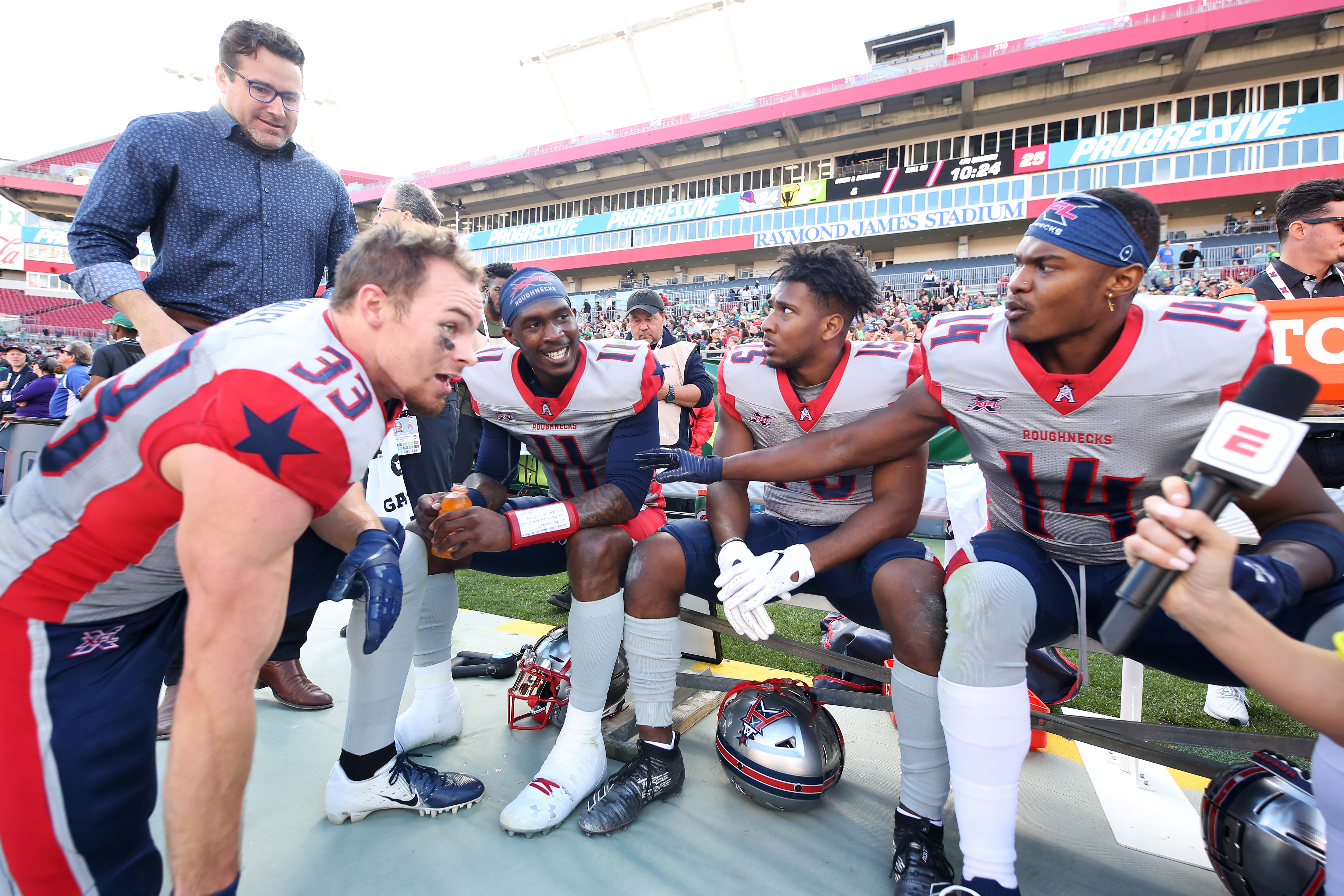 Nick Holley, P.J. Walker, Ryheem Malone, and Cam Phillips of the Houston Roughnecks are interviewed during the XFL game against the Tampa Bay Vipers at Raymond James Stadium on February 22, 2020 in Tampa, Florida.