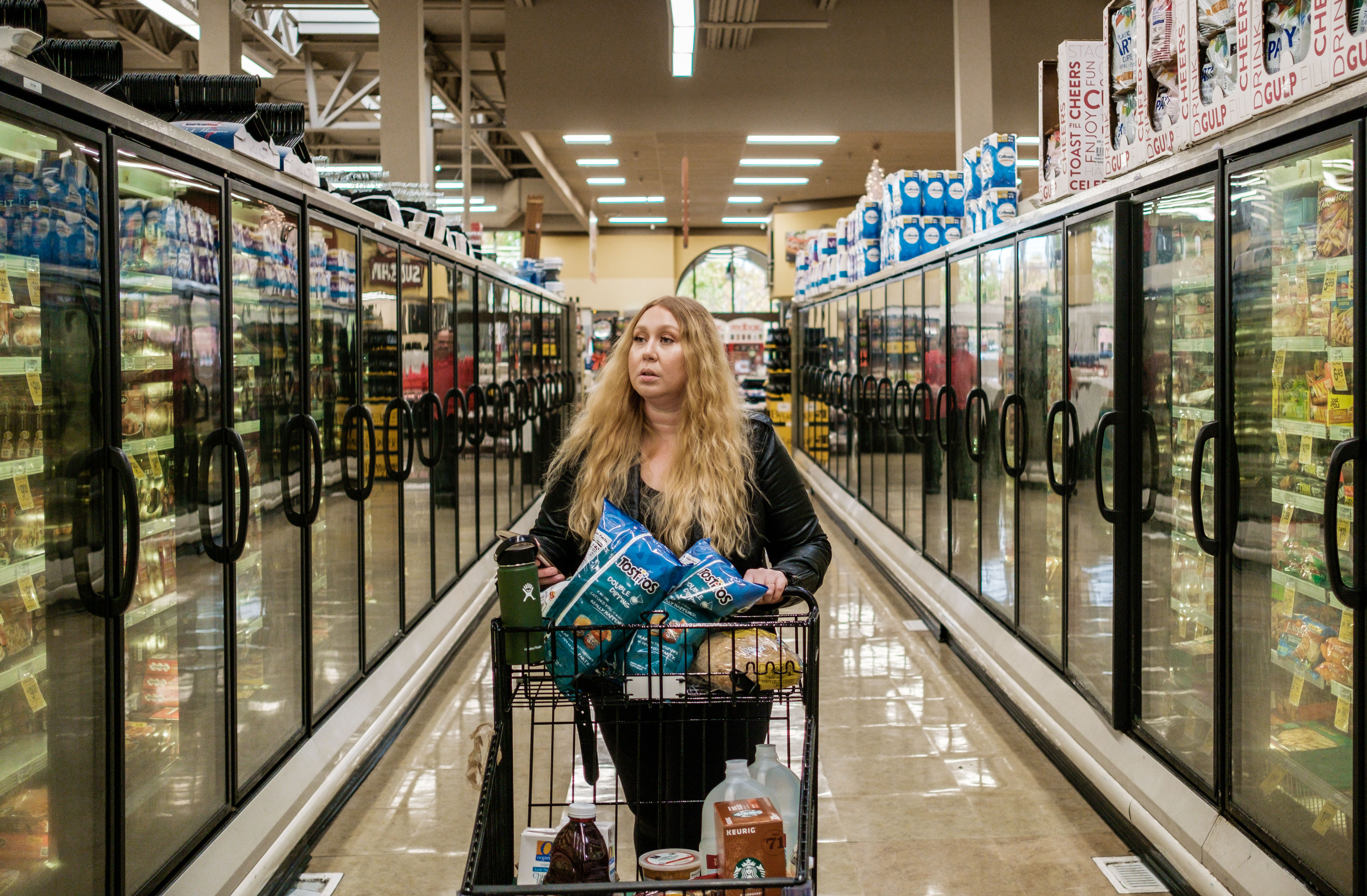 Instacart shopper Vanessa Bain shops for groceries for a customer at the Safeway in Menlo Park, California.