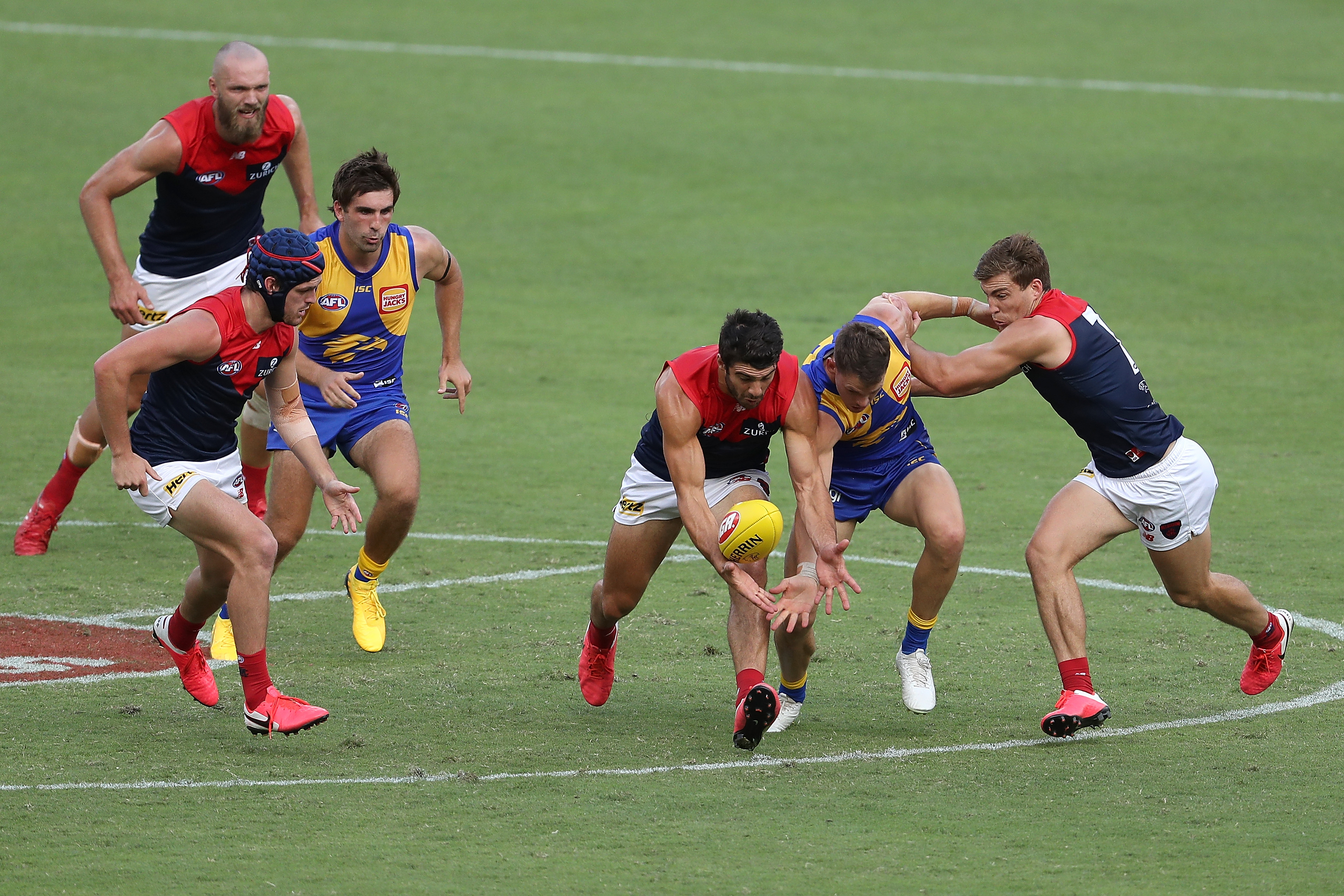 Christian Petracca of the Demons and Jack Redden of the Eagles contest for the ball during the round 1 AFL match between the West Coast Eagles and the Melbourne Demons at Optus Stadium on March 22, 2020 in Perth, Australia.