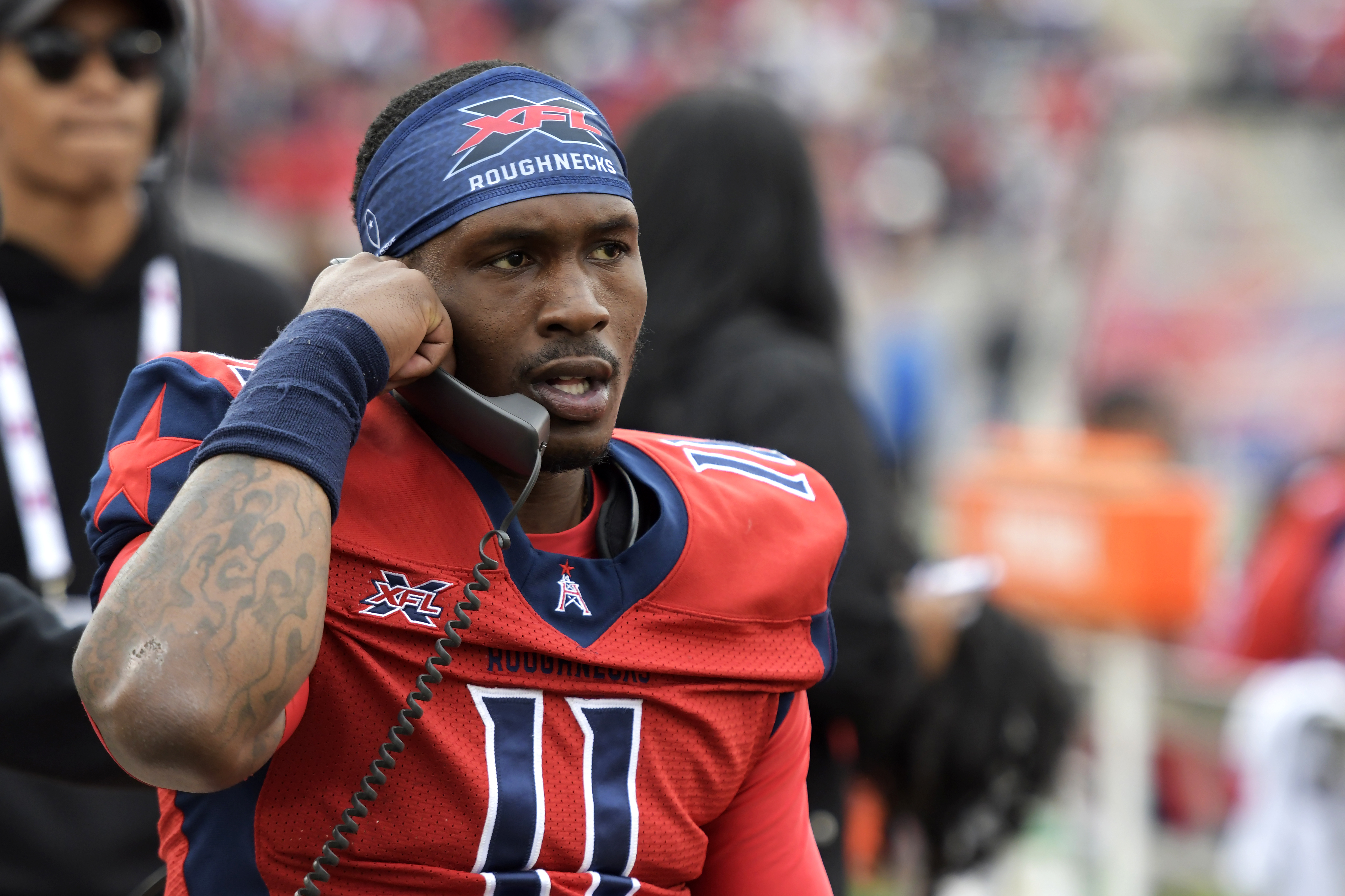 P.J. Walker of the Houston Roughnecks talks on the sideline phone during the XFL game against the Seattle Dragons at TDECU Stadium on March 7, 2020 in Houston, Texas.