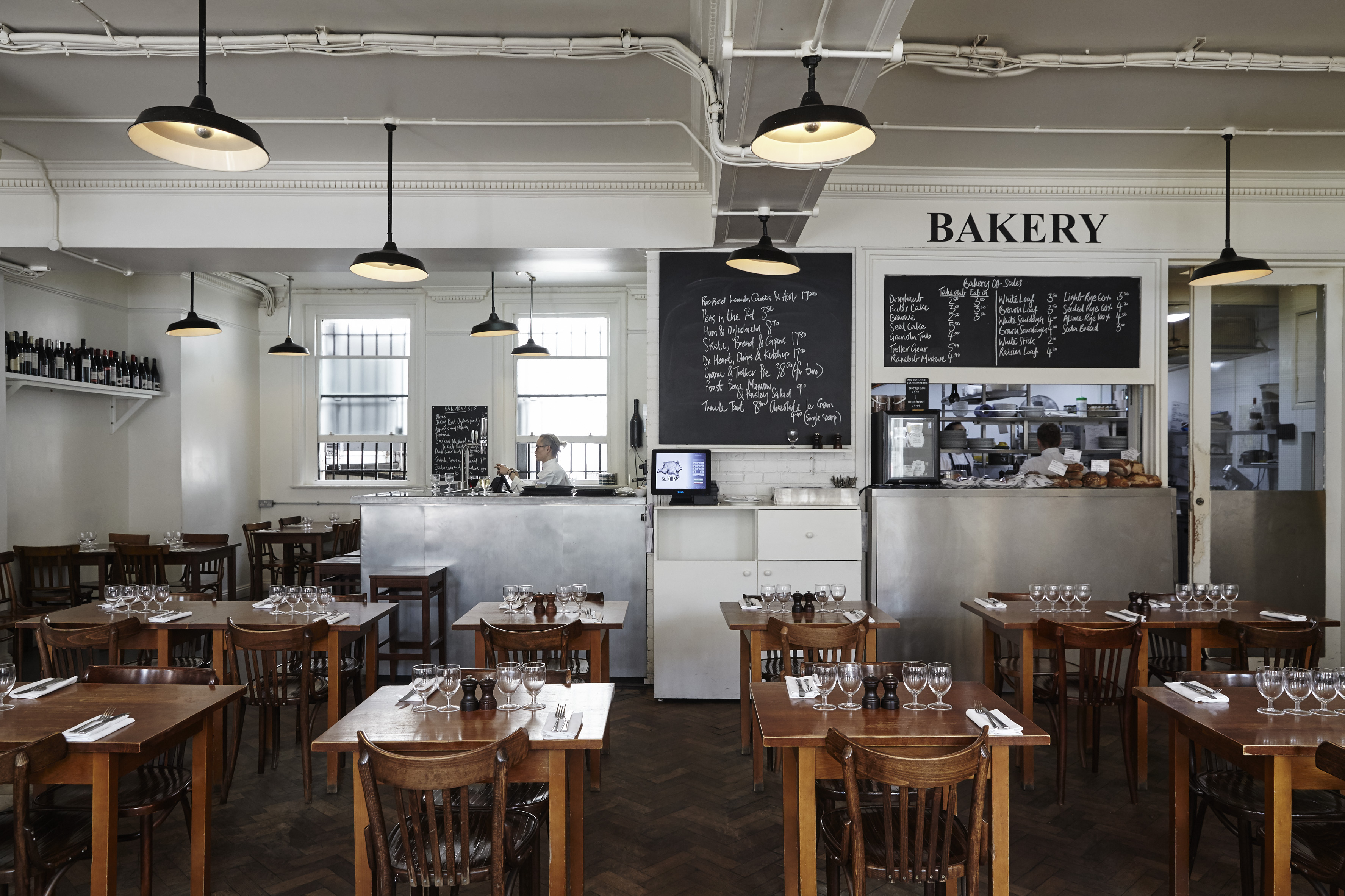 The dining room at Fergus Henderson's St. John Bread and Wine, the classic, modern British restaurant that forms part of the best 24 hour restaurant travel itinerary for London — where to eat with one day in the city