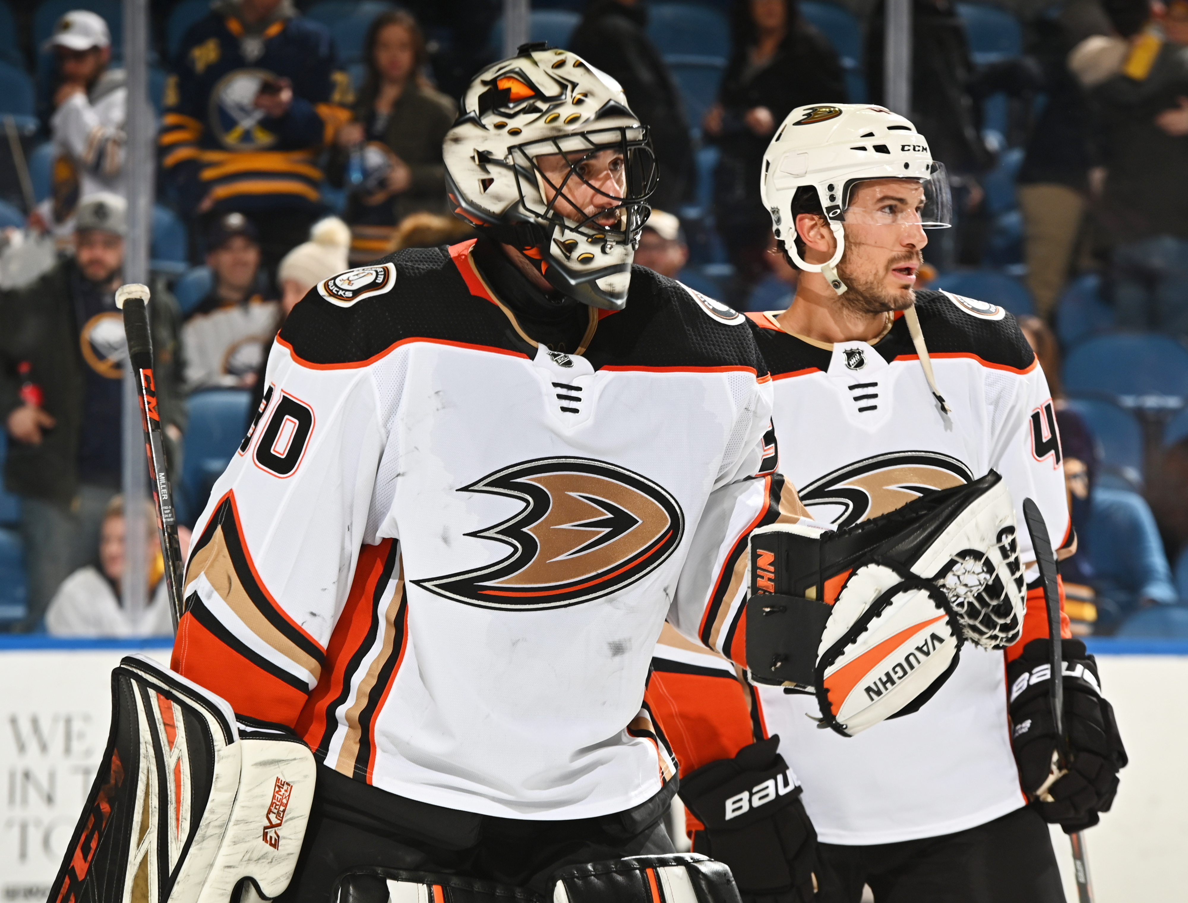 BUFFALO, NY - FEBRUARY 9: Michael Del Zotto #44 of the Anaheim Ducks congratulates Ryan Miller #30 following their 3-2 victory against the Buffalo Sabres an NHL game on February 9, 2020 at KeyBank Center in Buffalo, New York.