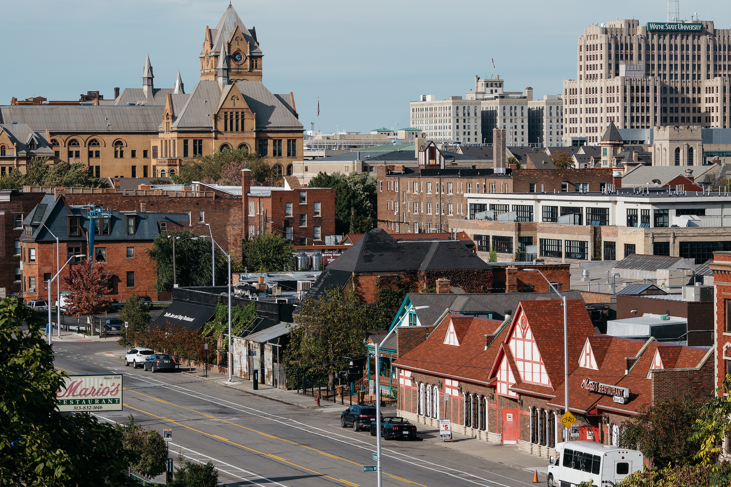 A view of Cass Corridor from above with Mario's in the foreground on a sunny day.