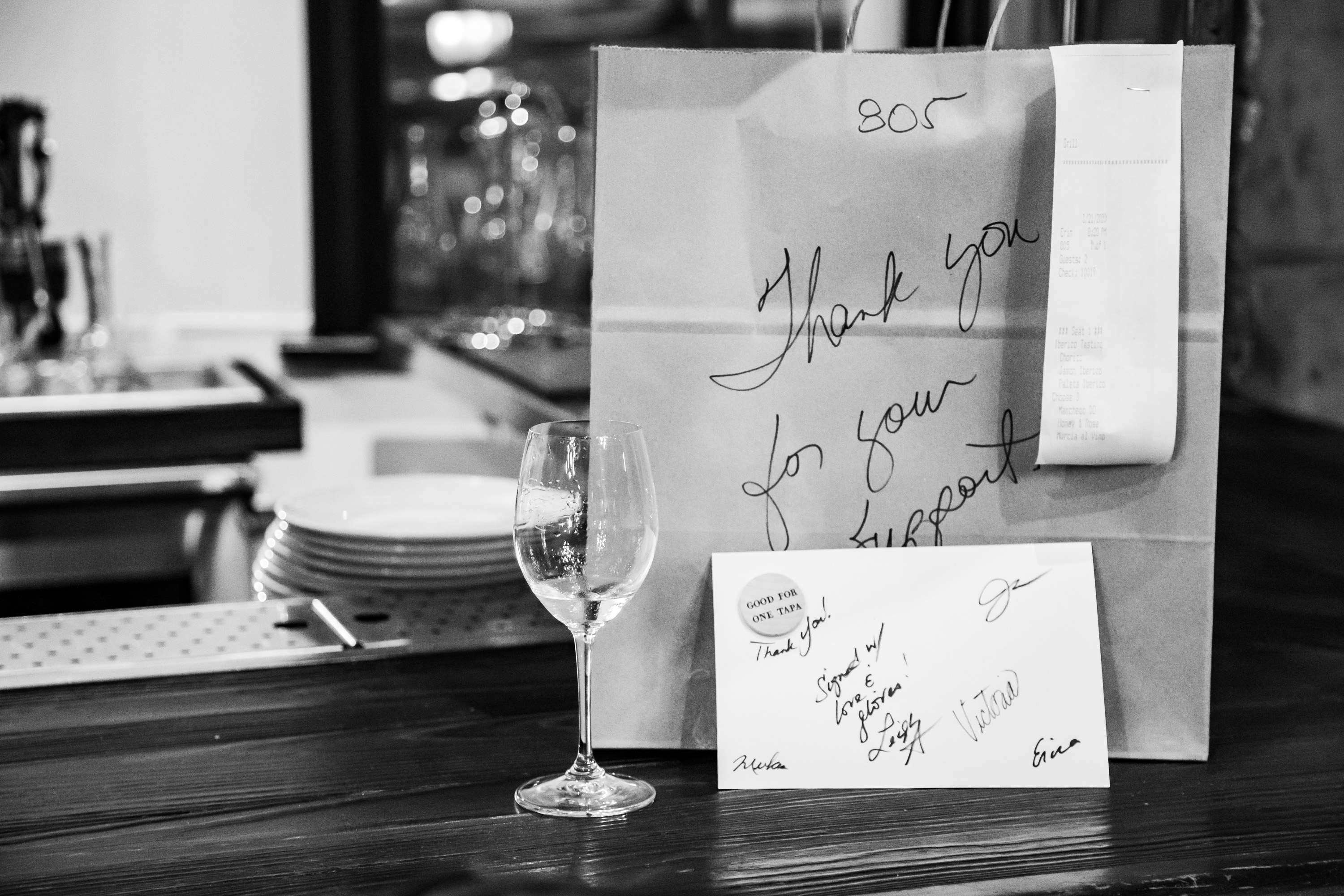 Handwritten note from Iberian Pig in Buckhead on a takeout bag amid COVID-19