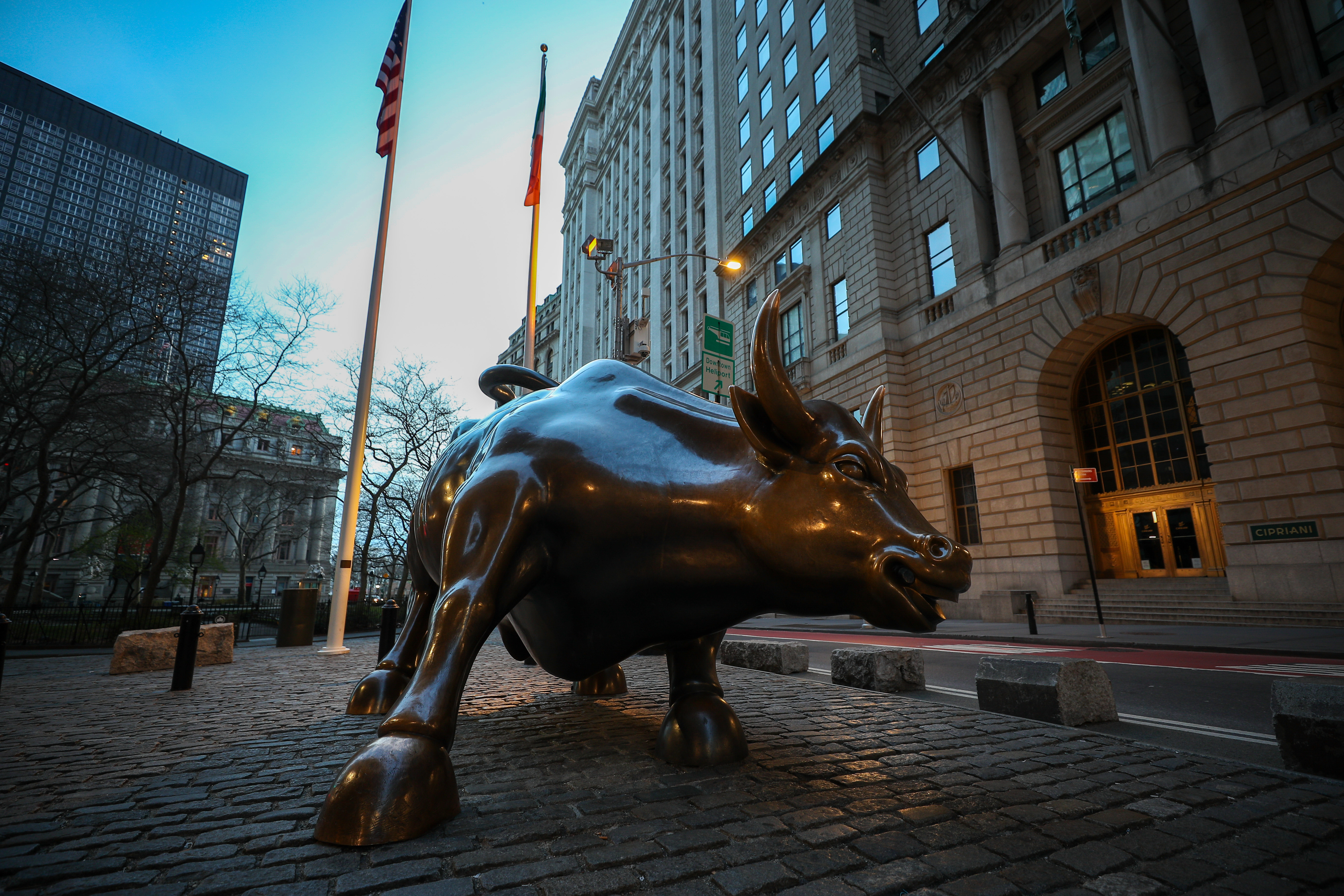 The famous Charging Bull Statue is seen lonely at the Financial District in New York.