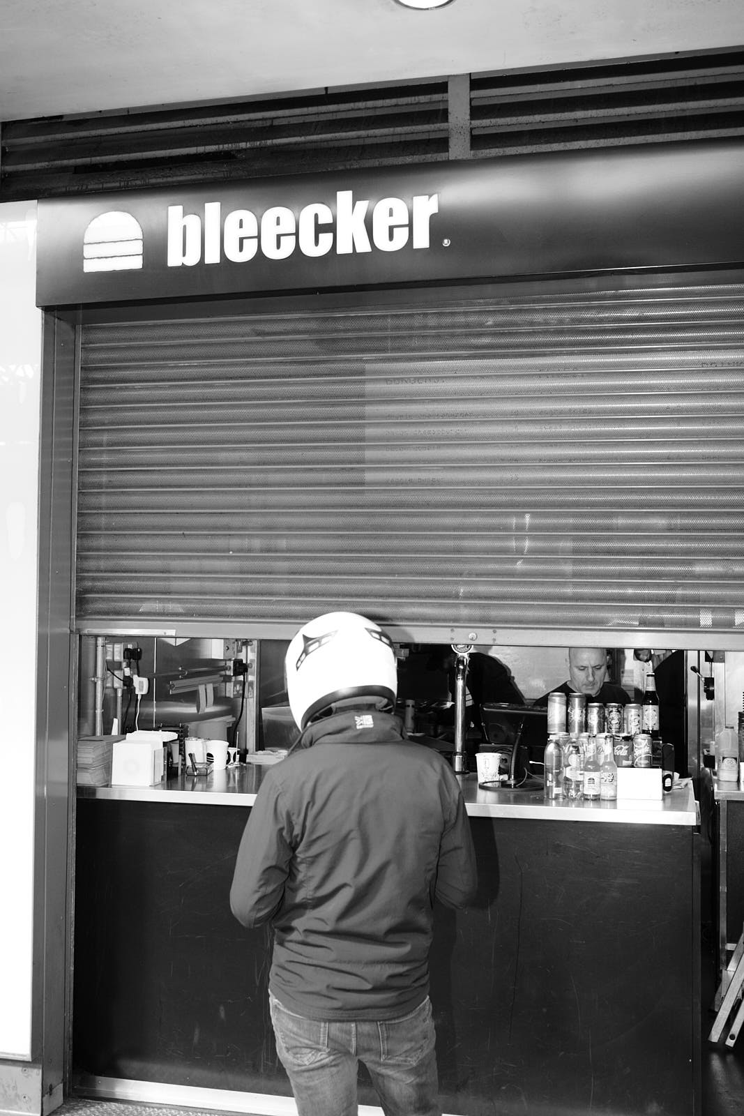 A delivery driver waits outside Bleecker Burger at Old Spitalfields Market