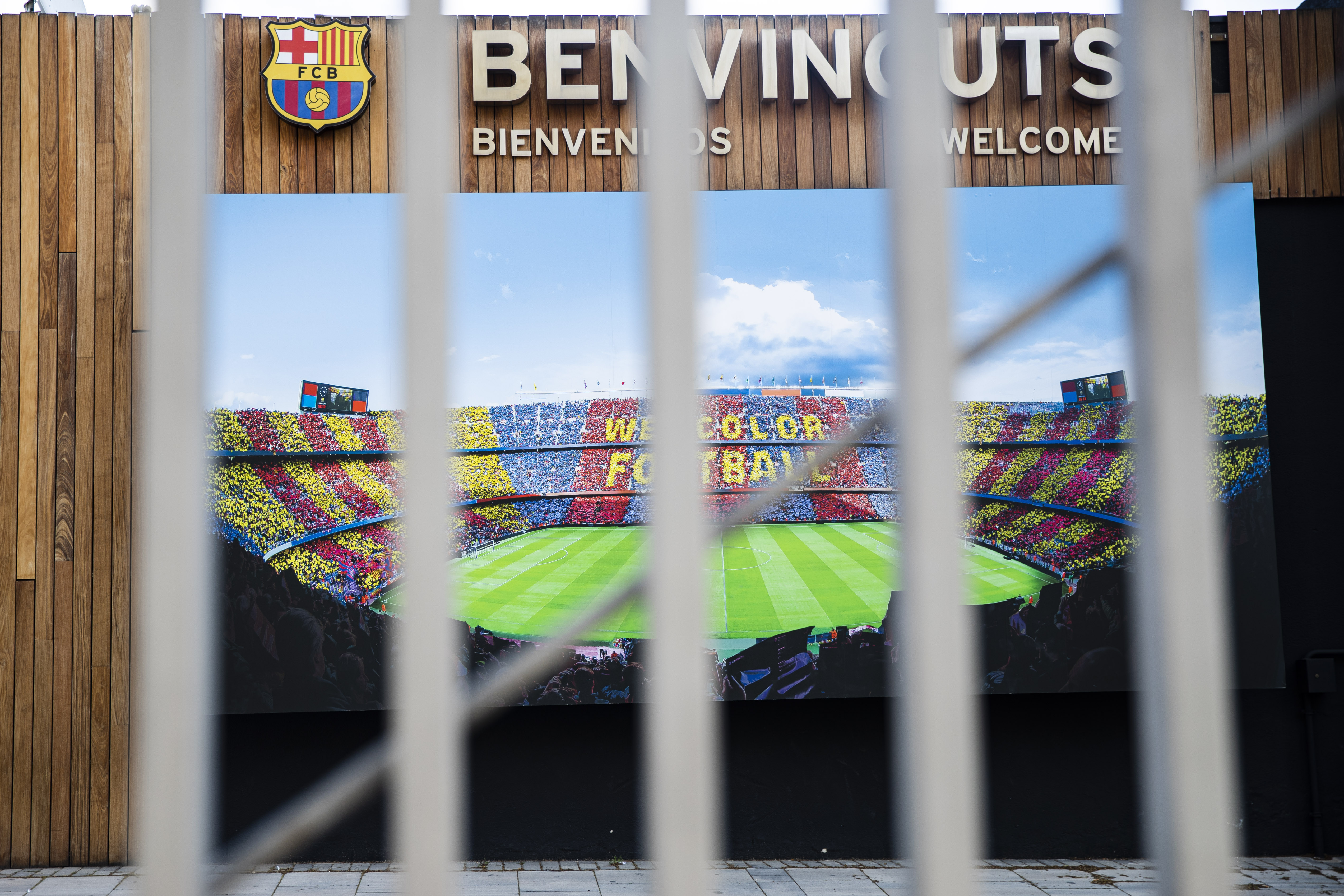 Photograph of the exterior of Camp Nou through a locked gate after Spain imposed a lockdown on Catalonia.