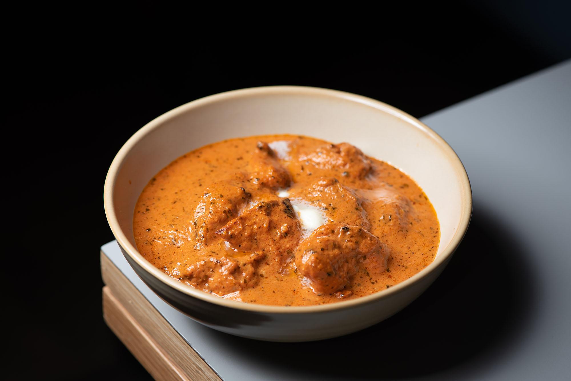 Badmaash Fairfax's orange bowl of curried chicken.