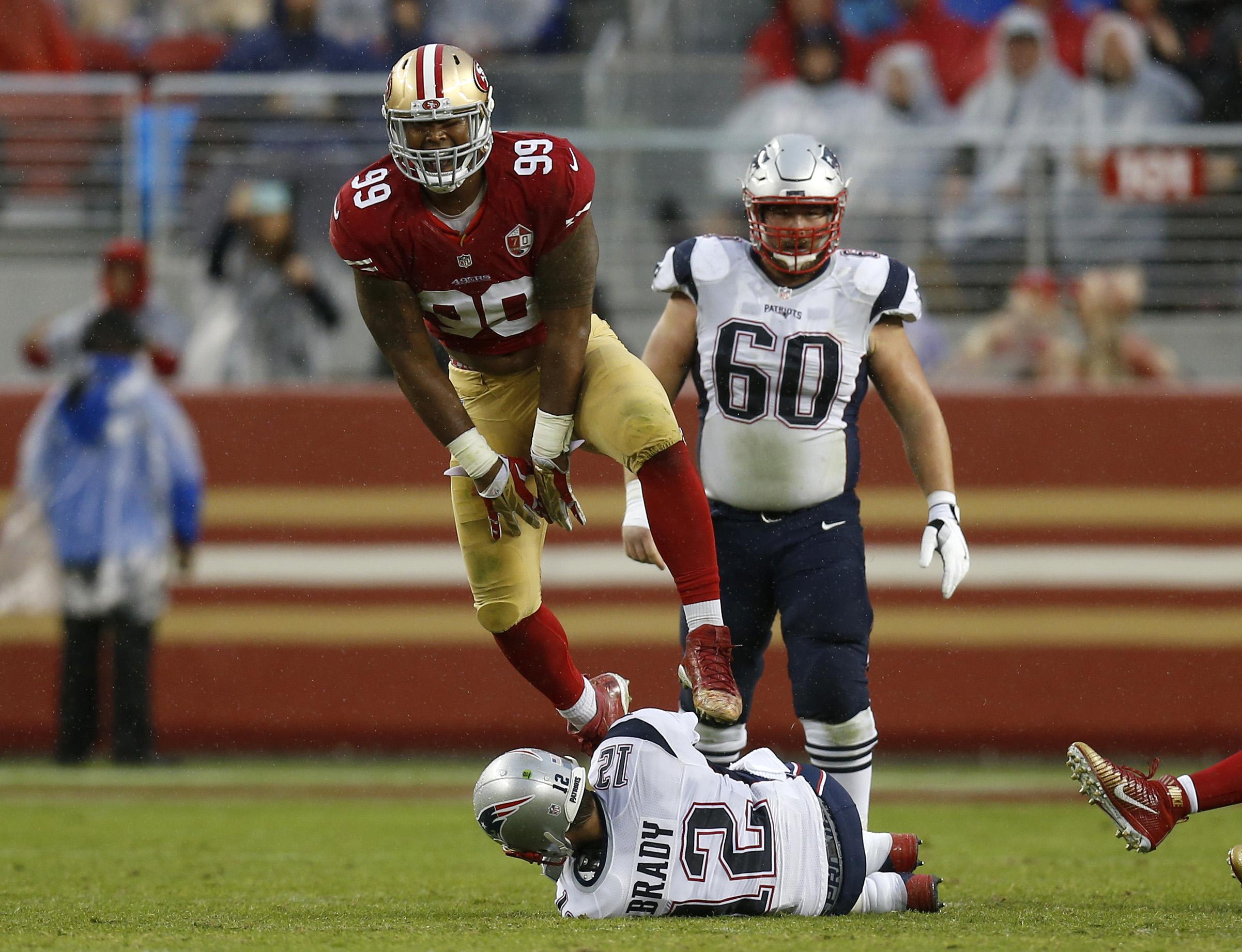 San Francisco 49ers' DeForest Buckner (99) celebrates his sack against New England Patriots starting quarterback Tom Brady (12) in the second quarter of their NFL game at Levi's Stadium in Santa Clara, Calif., on Sunday, Nov. 20, 2016. (Nhat V. Meyer/Bay