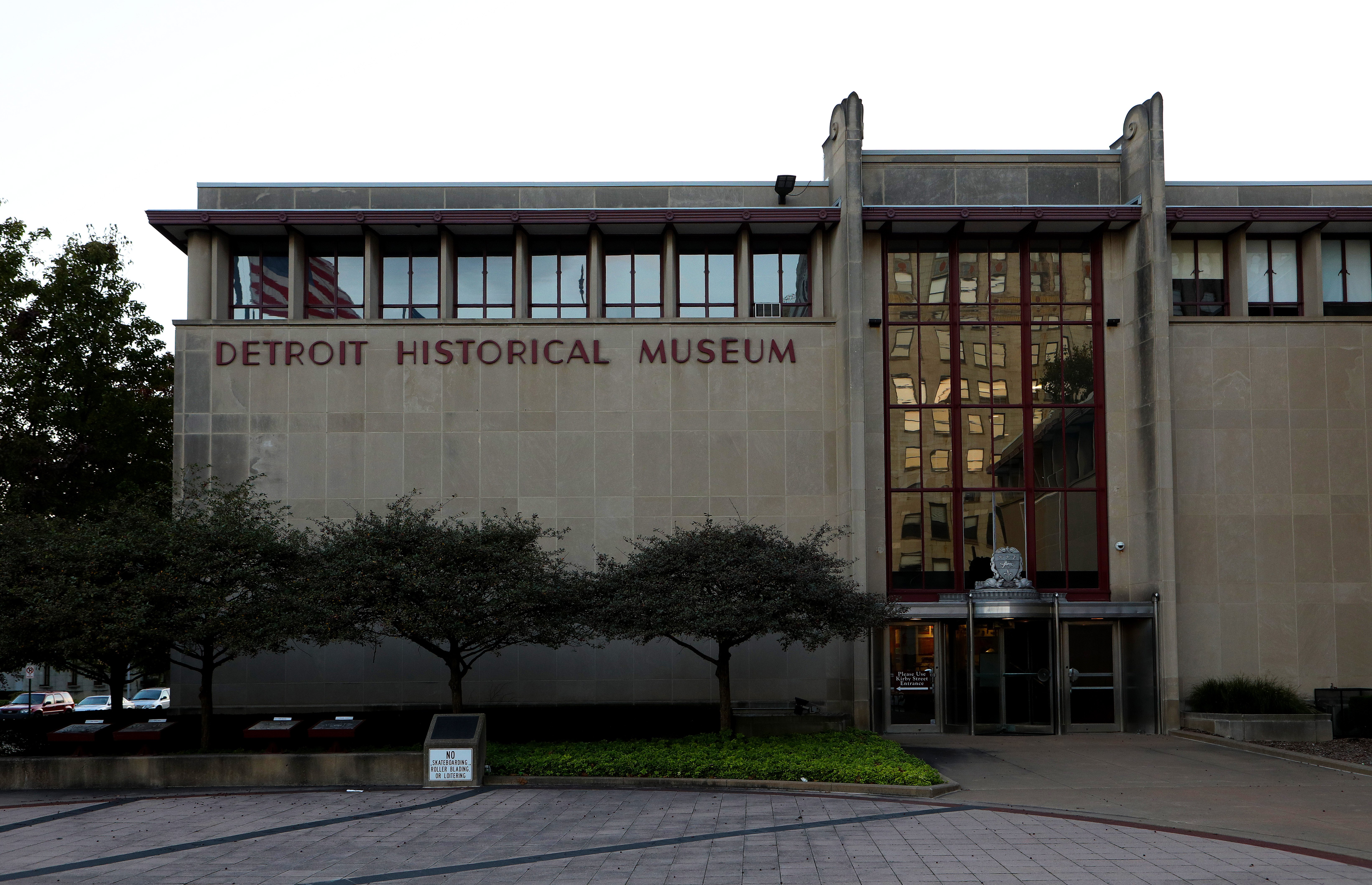 """Exterior of a concrete building that says """"Detroit Historical Museum"""" in red lettering."""