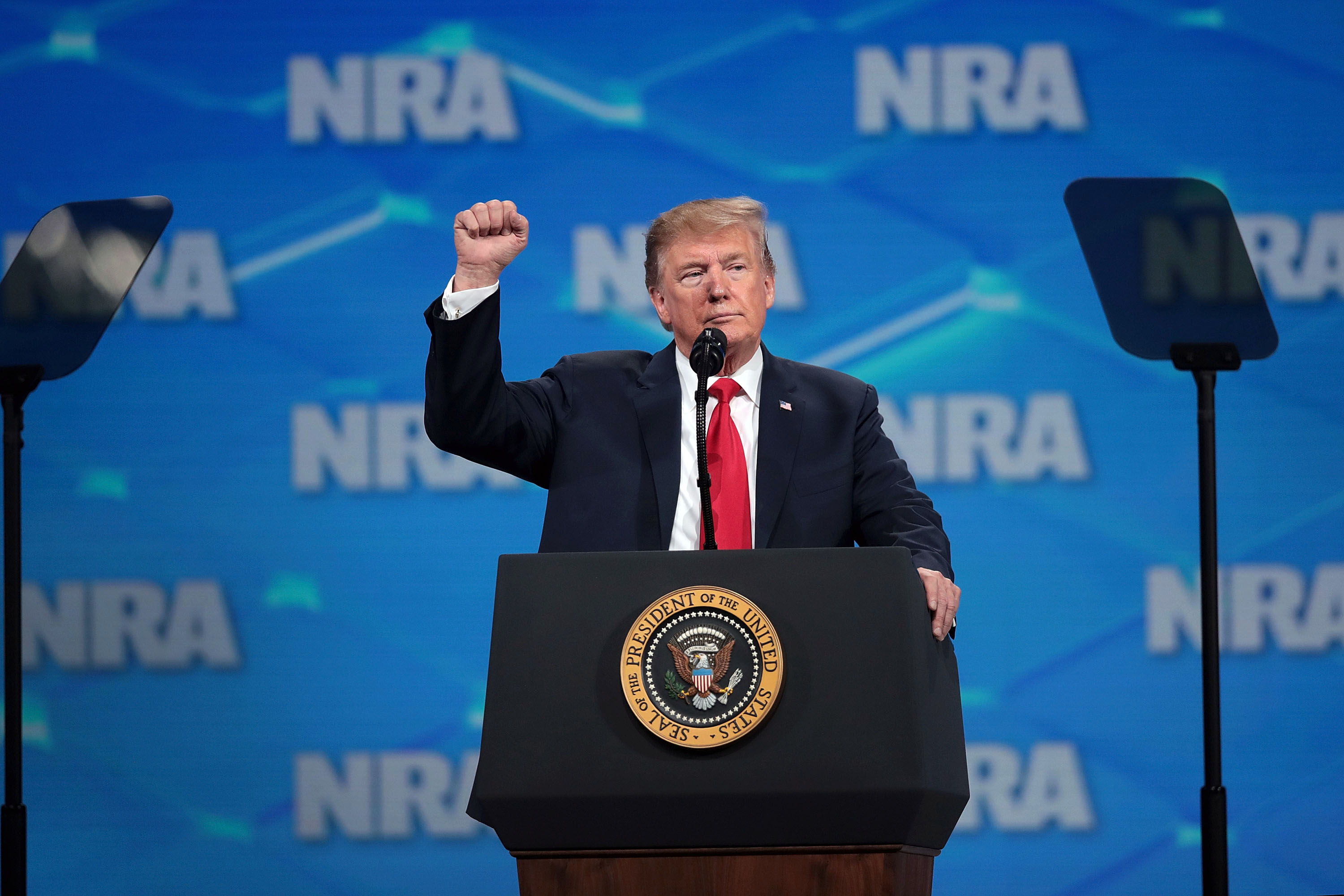 President Donald Trump gestures to guests at the National Rifle Association's annual meeting in Indianapolis in 2019