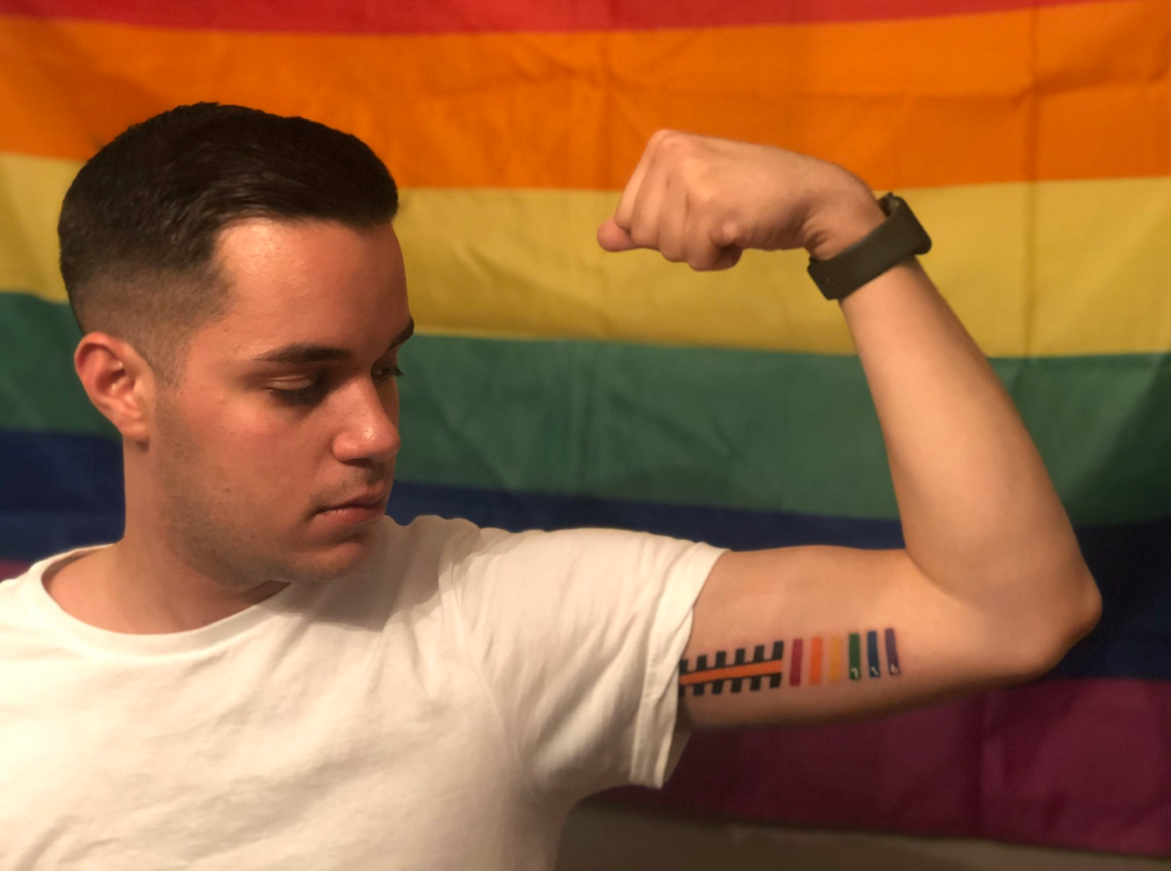 Outsports reader Alex Valvo took us to the gun show to display his tattoo on his left upper arm.