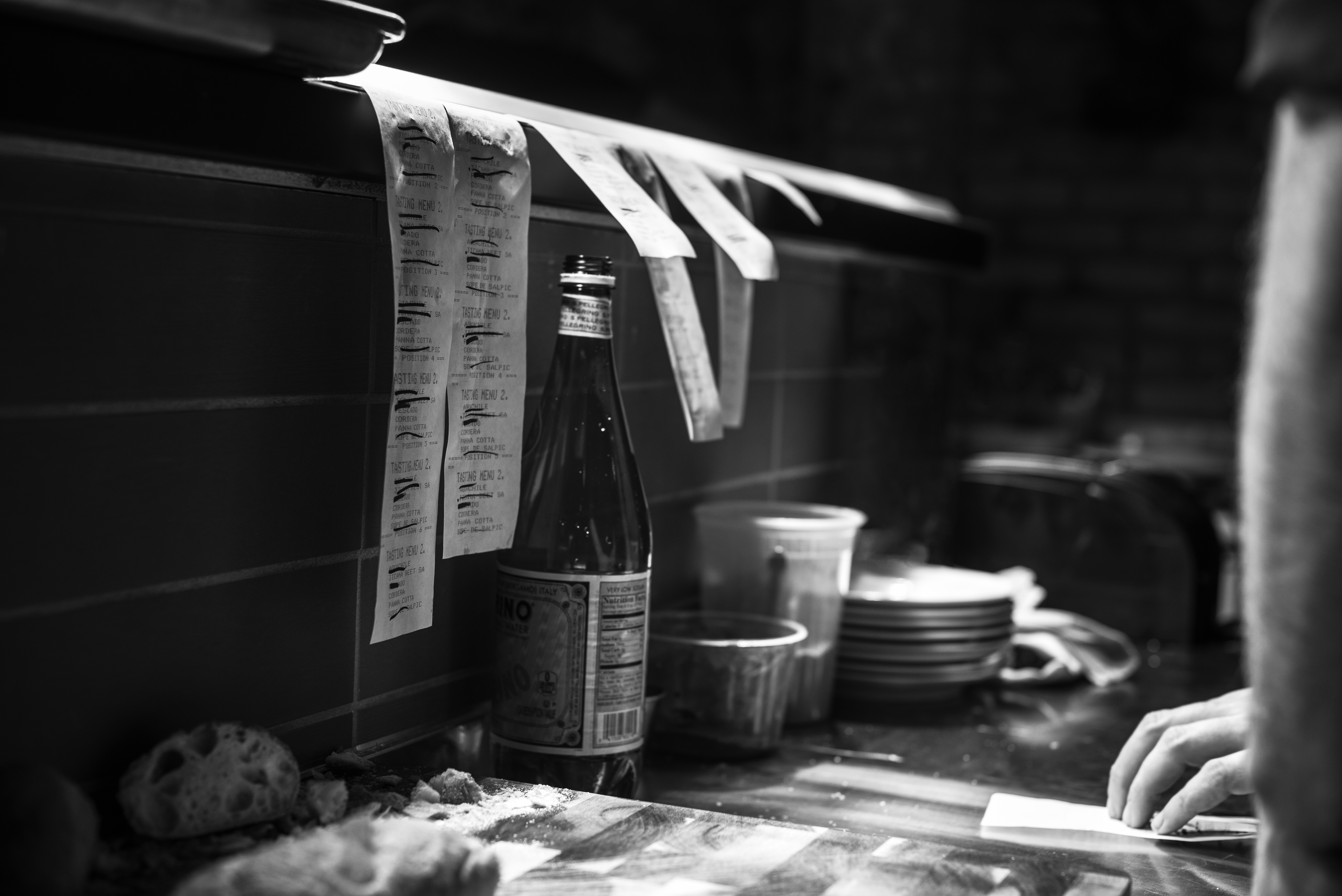 A kitchen line filled with ticket orders