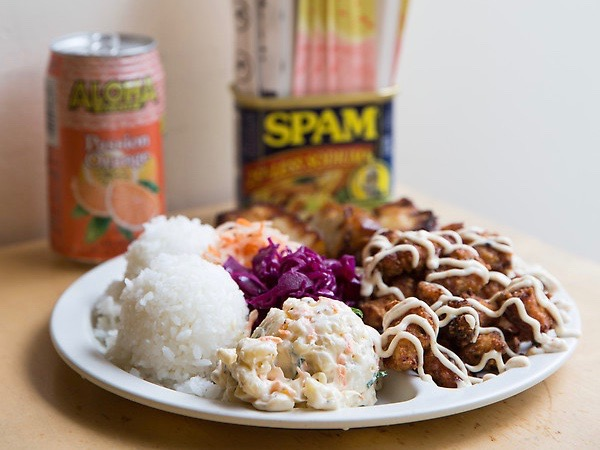plate with scoops of rice, macaroni salad, and red cabbage
