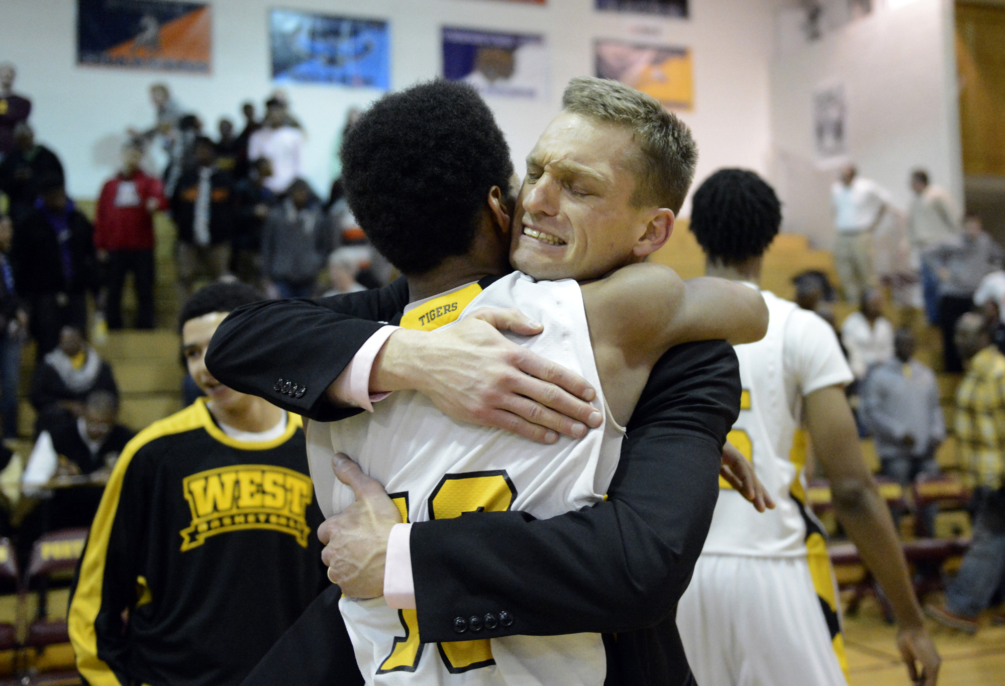 Joliet West's Brandon McCullum and coach Luke Yaklich after the win over TF North in 2013.