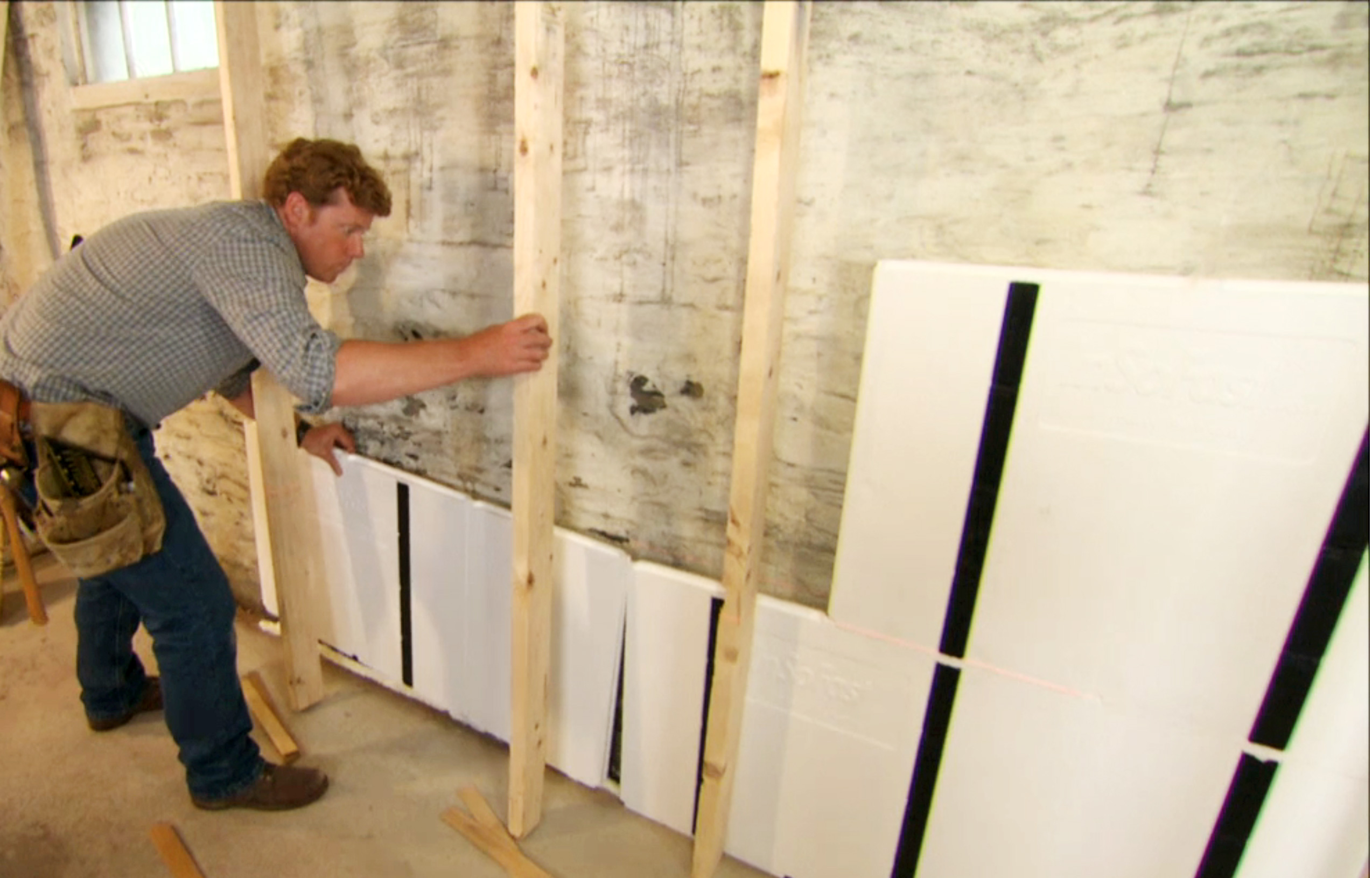 Kevin O'Connor lends a hand installing InSoFast foam panels at the Cambridge 2012 project