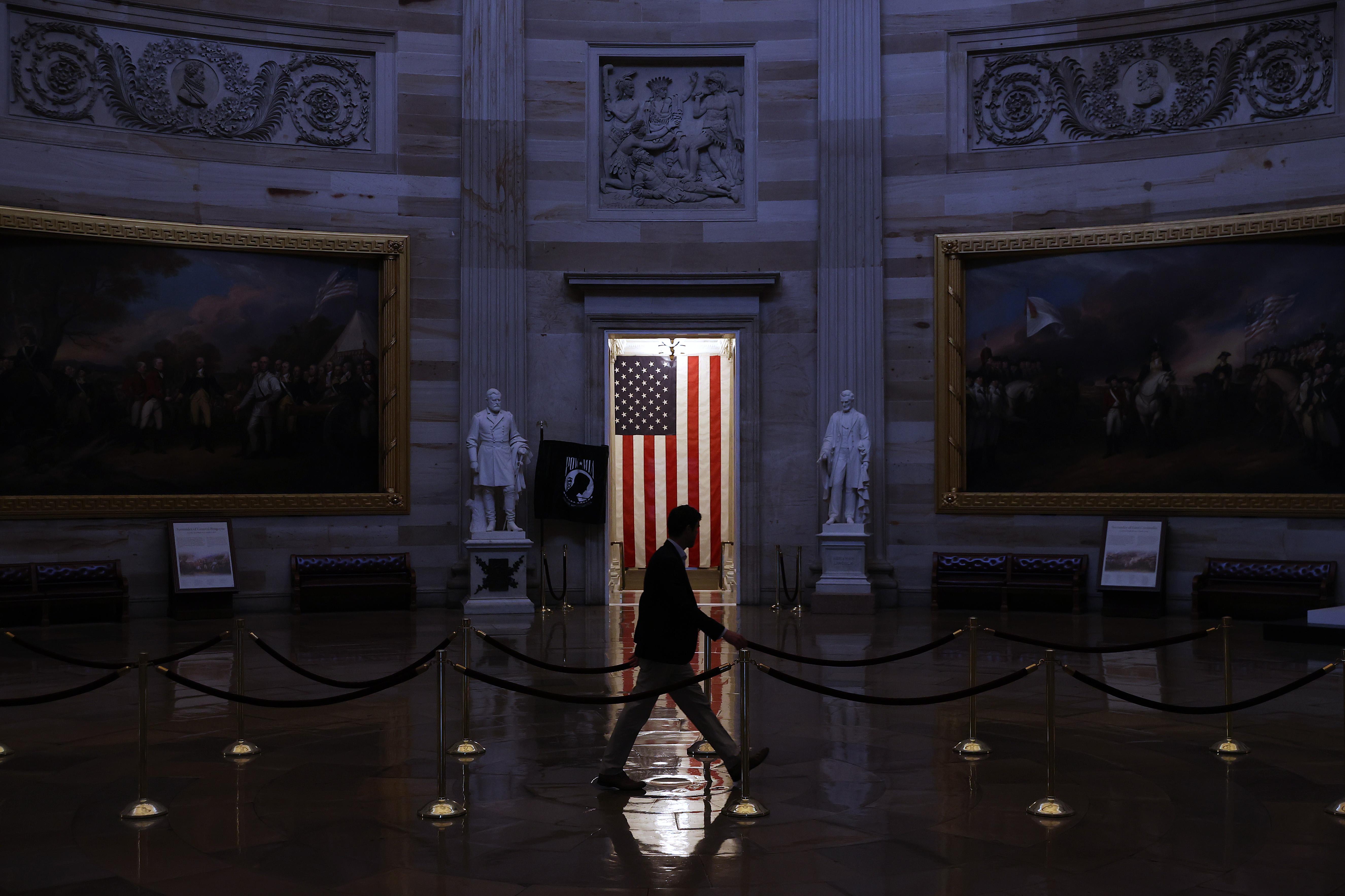 A man walks through the empty U.S. Capitol Rotunda, empty