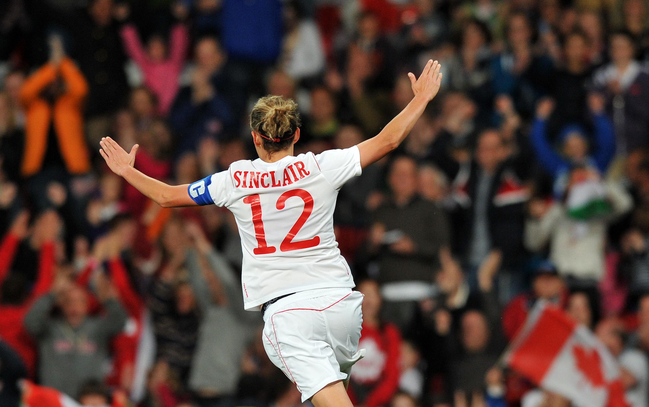 Canada's forward Christine Sinclair cele