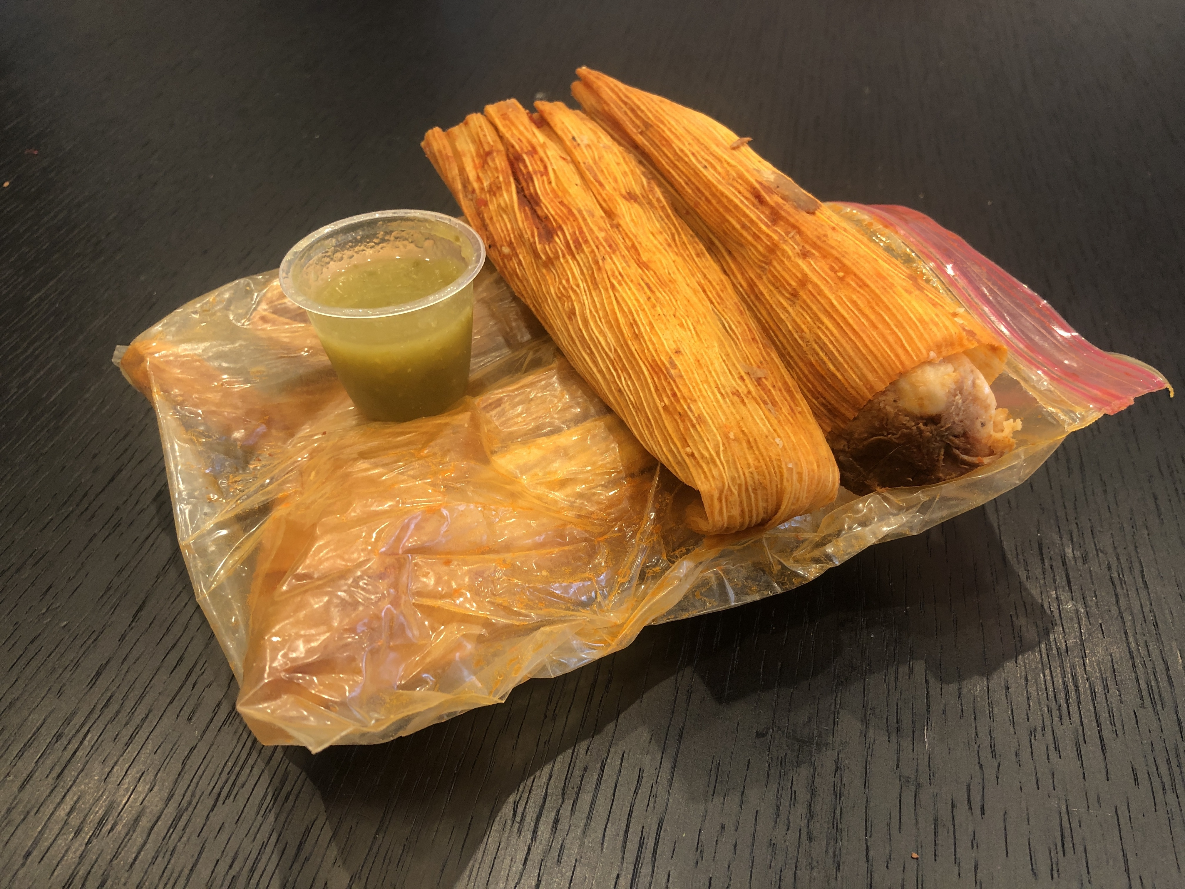 Six tamales in a plastic bag.
