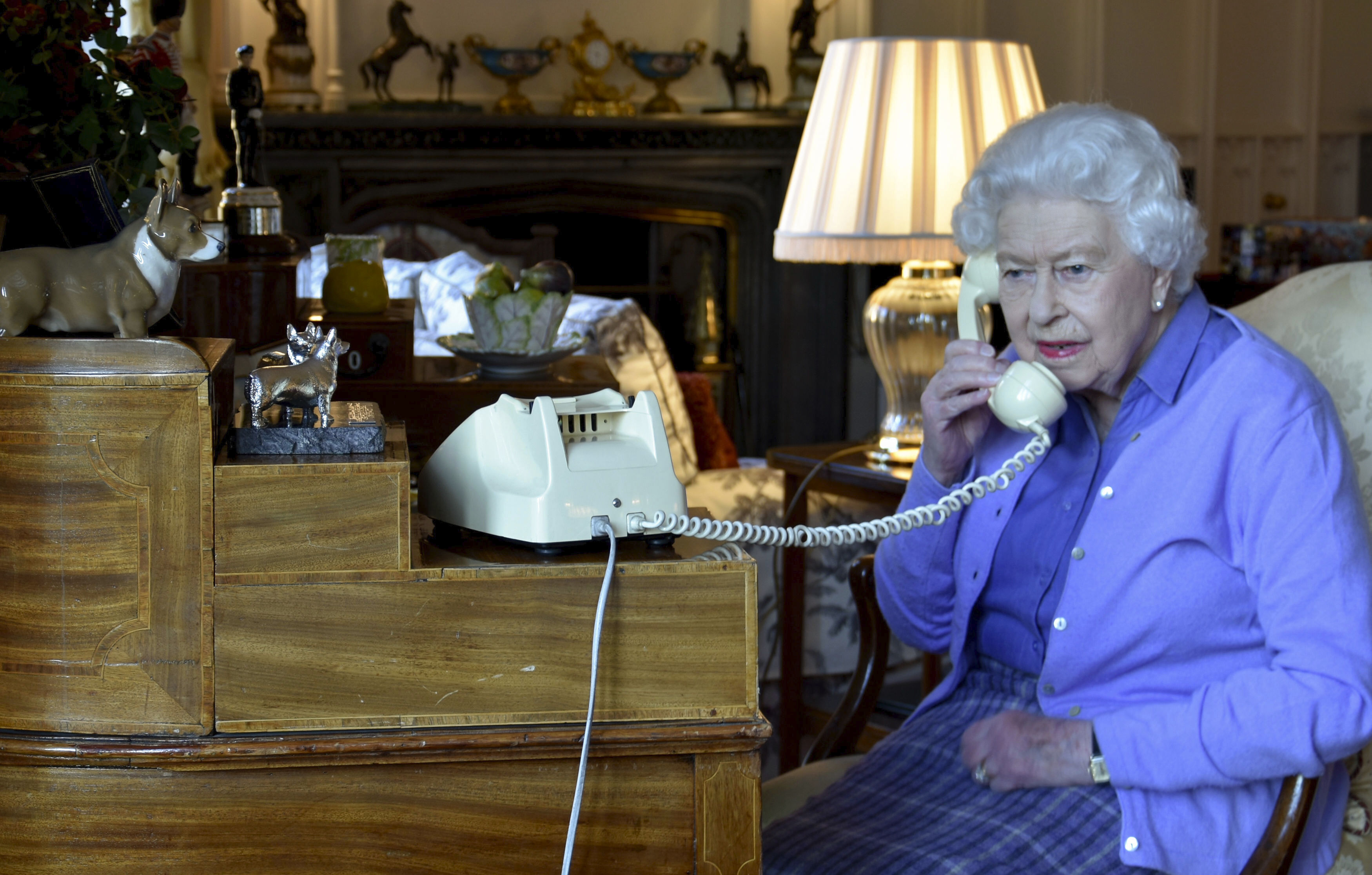 In this photo made available by Buckingham Palace, Britain's Queen Elizabeth II speaks to Prime Minister Boris Johnson from Windsor Castle, Windsor, England, Wednesday March 25, 2020, for her weekly audience.